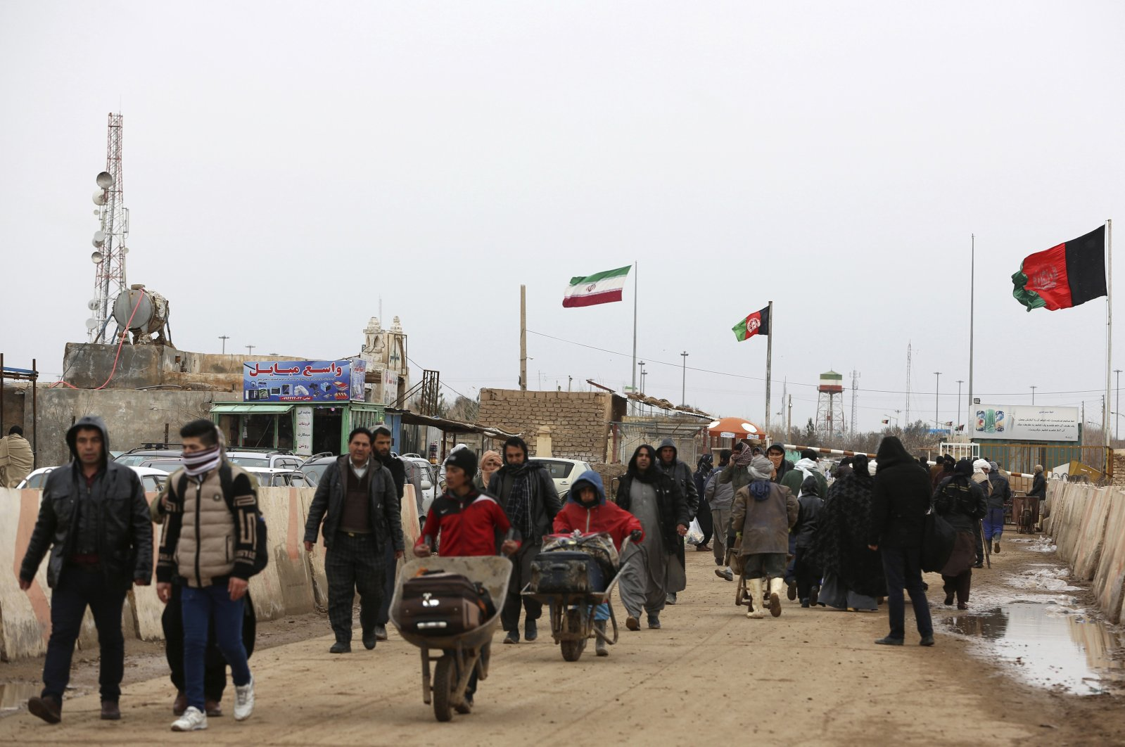 Afghans return to Afghanistan at the Islam Qala border with Iran, in the western Herat province, Afghanistan, Feb. 20, 2019. (AP Photo)