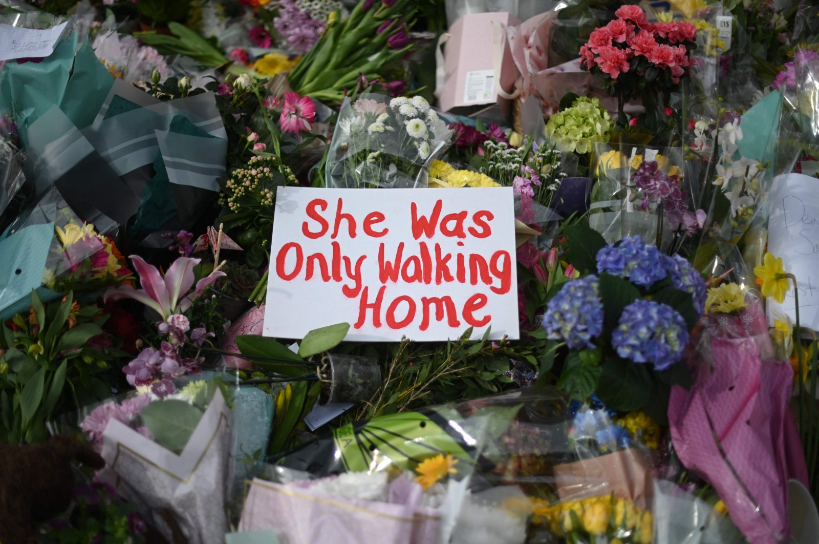 Messages and floral tributes left by well-wishers to honor victim Sarah Everard at the bandstand on Clapham Common in south London, U.K., March 14, 2021. (AFP Photo)