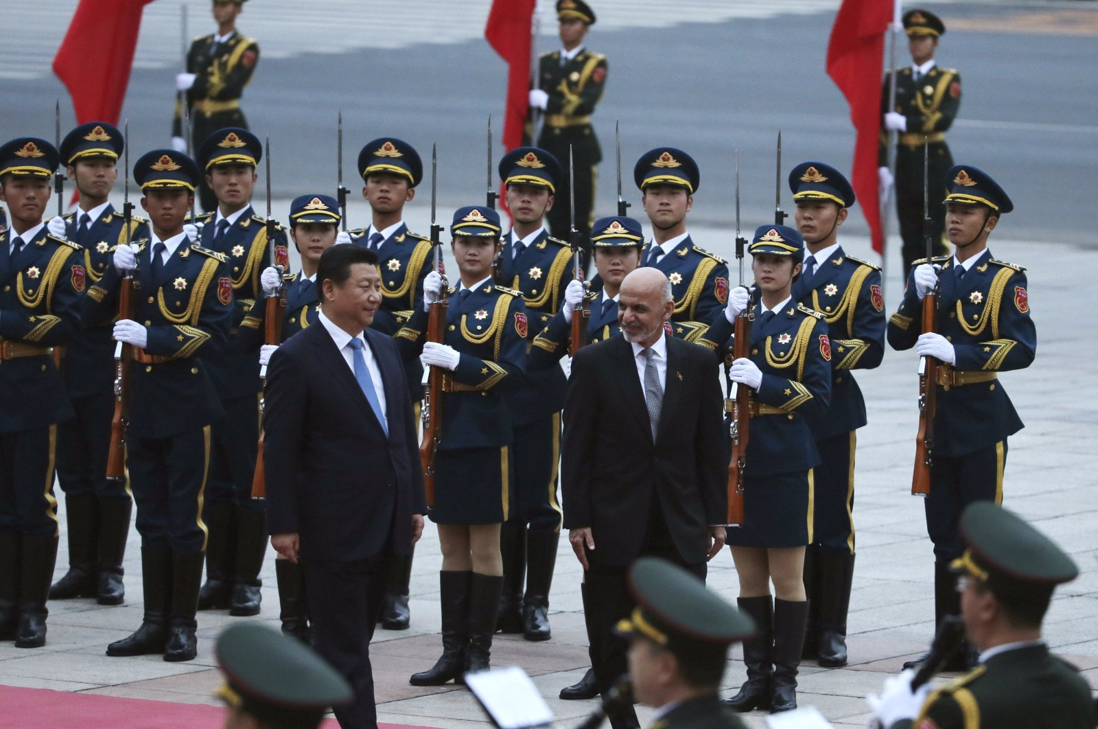 Afghan President Ashraf Ghani Ahmadzai, center right, and Chinese President Xi Jinping, center left, review a guard of honor during a welcome ceremony outside the Great Hall of the People in Beijing, China, Oct. 28, 2014. (AP Photo)