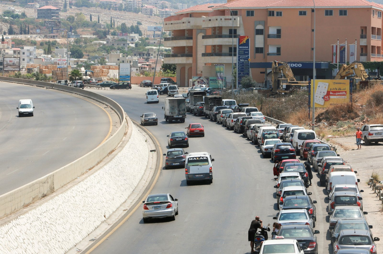 Cars line up to buy fuel at a gas station in Jiyeh, Lebanon, June 29, 2021. (Reuters Photo)