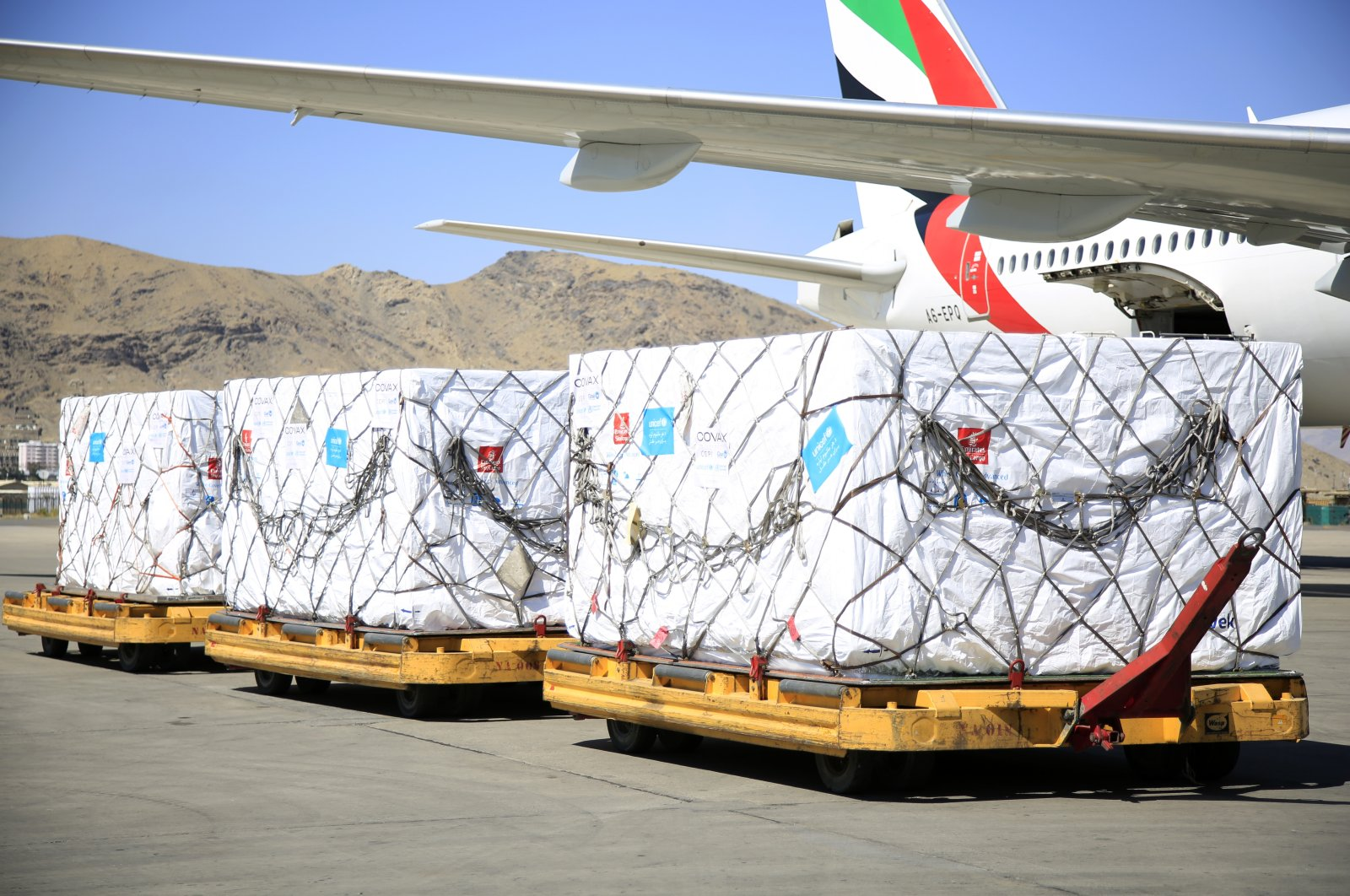 The first shipment of 1.4 million Johnson & Johnson COVID-19 vaccine doses arrives at the Hamid Karzai International Airport, in Kabul, Afghanistan, July 9, 2021. (AP Photo)