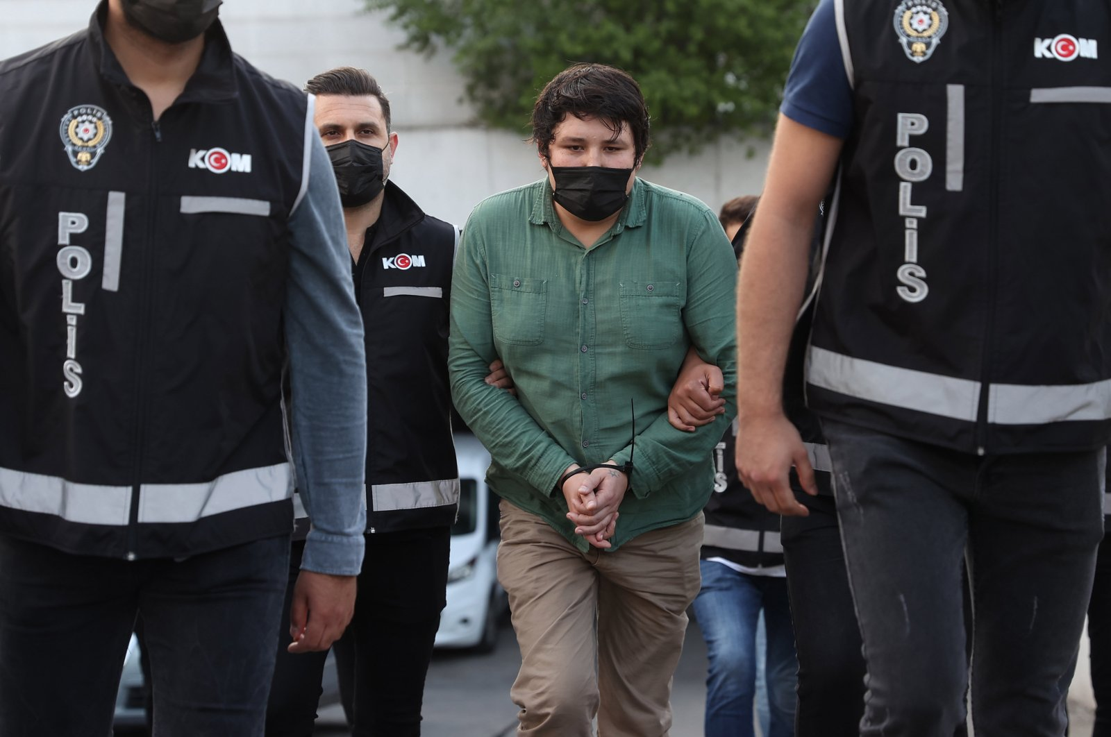 Police escort Mehmet Aydın, brother of Fatih Aydın, to the courthouse, in Istanbul, Turkey, July 7, 2021. (AA PHOTO)