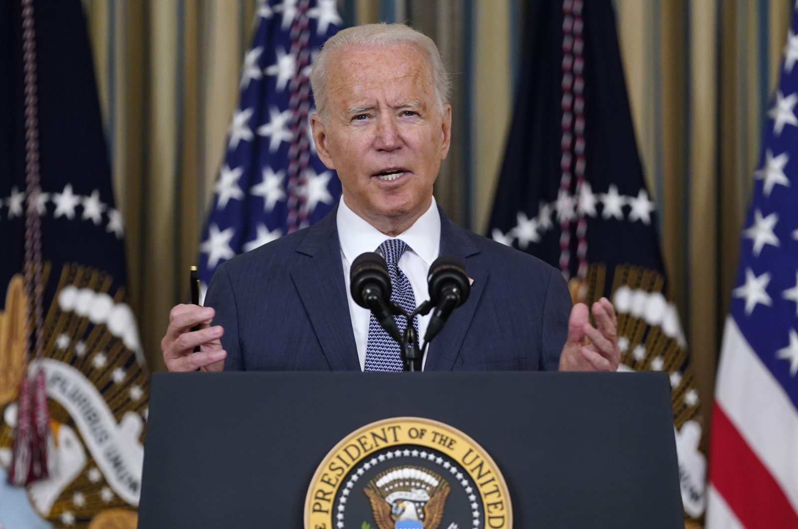 U.S. President Joe Biden speaks before signing an executive order aimed at promoting competition in the economy, in the State Dining Room of the White House, Washington, July 9, 2021. (AP Photo)