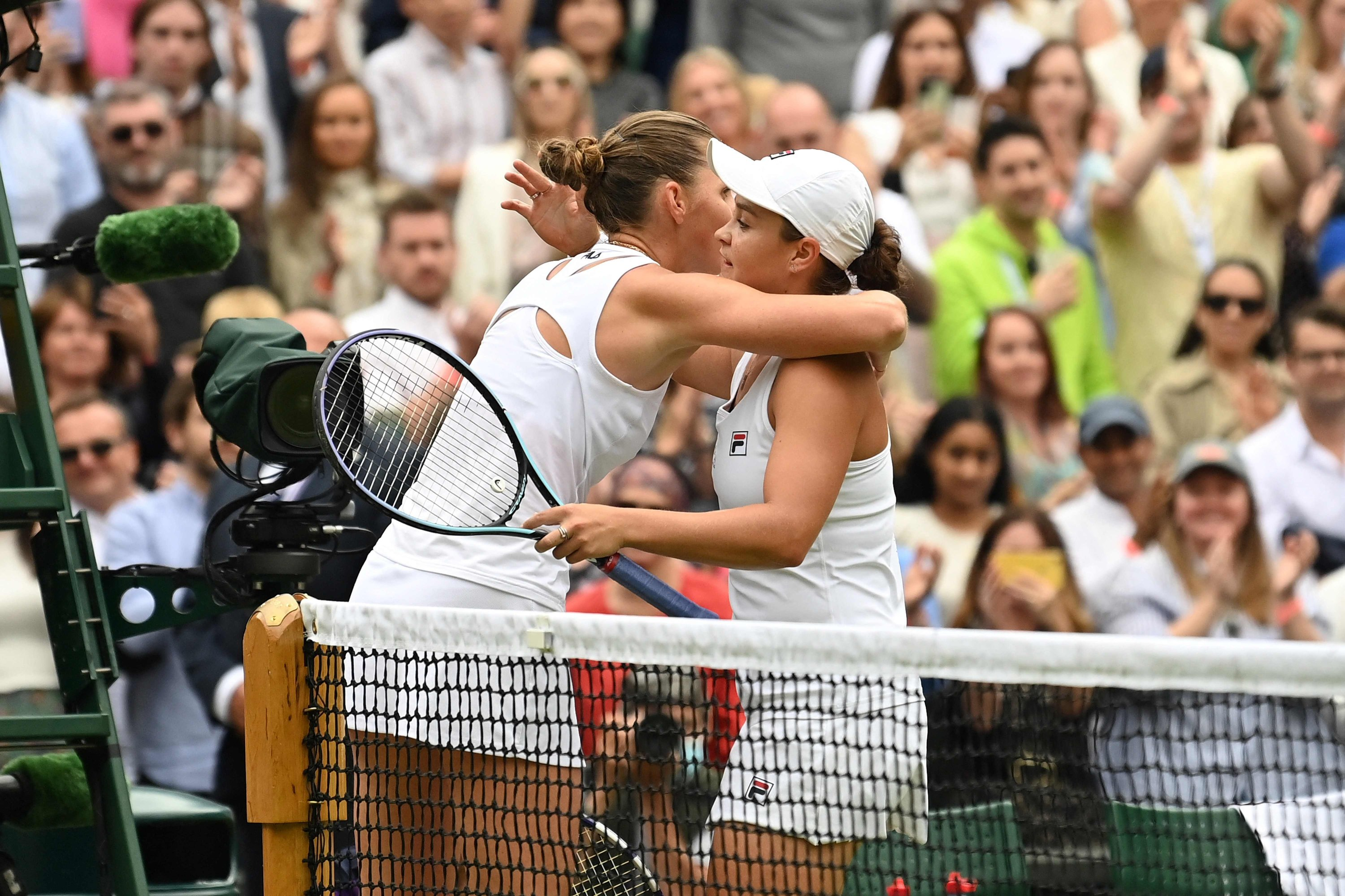 Australia's Ashleigh Barty (R) embraces Czech Republic's Karolina Pliskova after winning their women's singles final match on the 12th day of the 2021 Wimbledon Championships at the All England Tennis Club in Wimbledon, southwest London, on July 10, 2021. (AFP Photo)