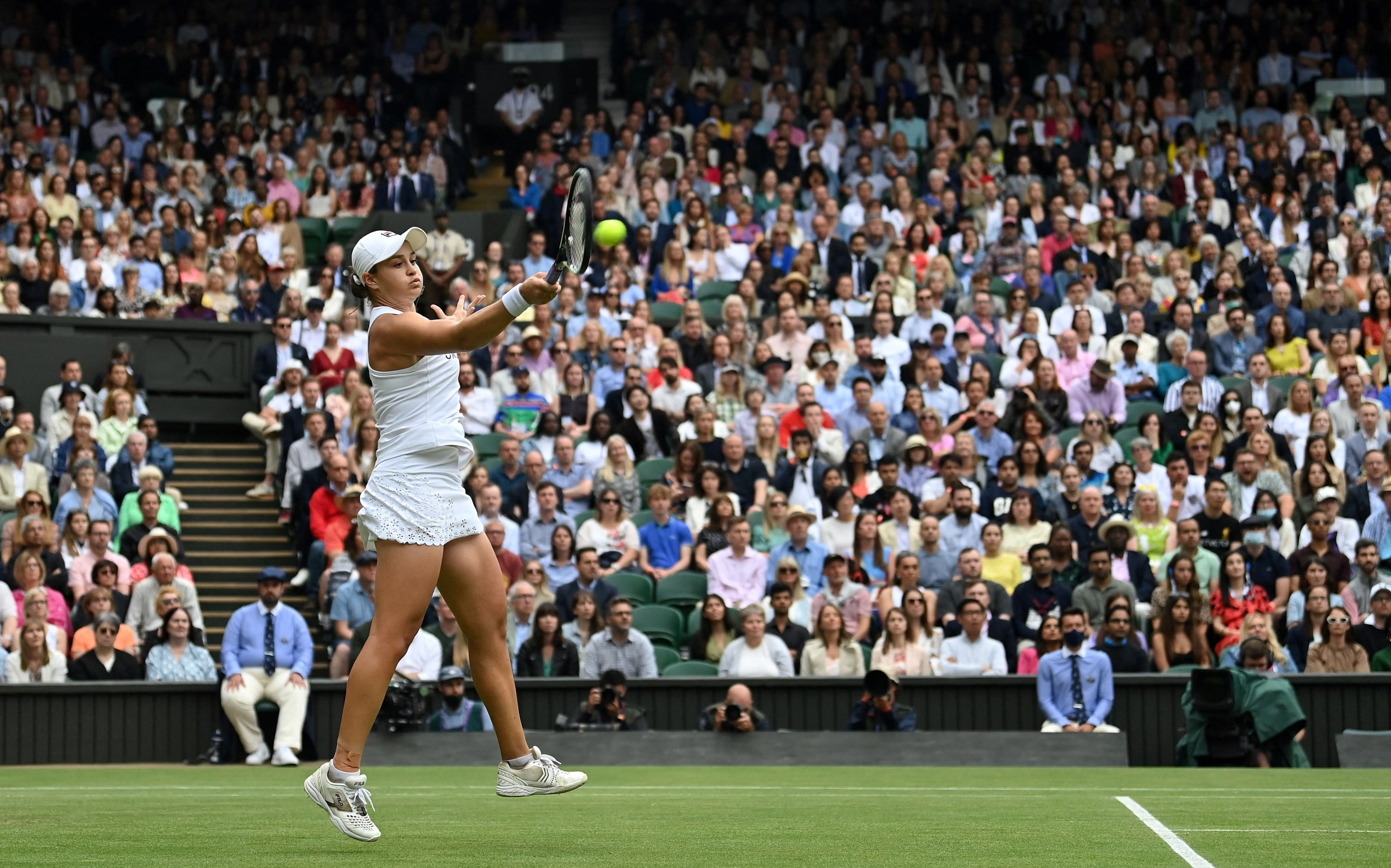Australia's Ashleigh Barty returns against Czech Republic's Karolina Pliskova during their women's singles final match on the twelfth day of the 2021 Wimbledon Championships at The All England Tennis Club in Wimbledon, southwest London, on July 10, 2021. (AFP Photo)