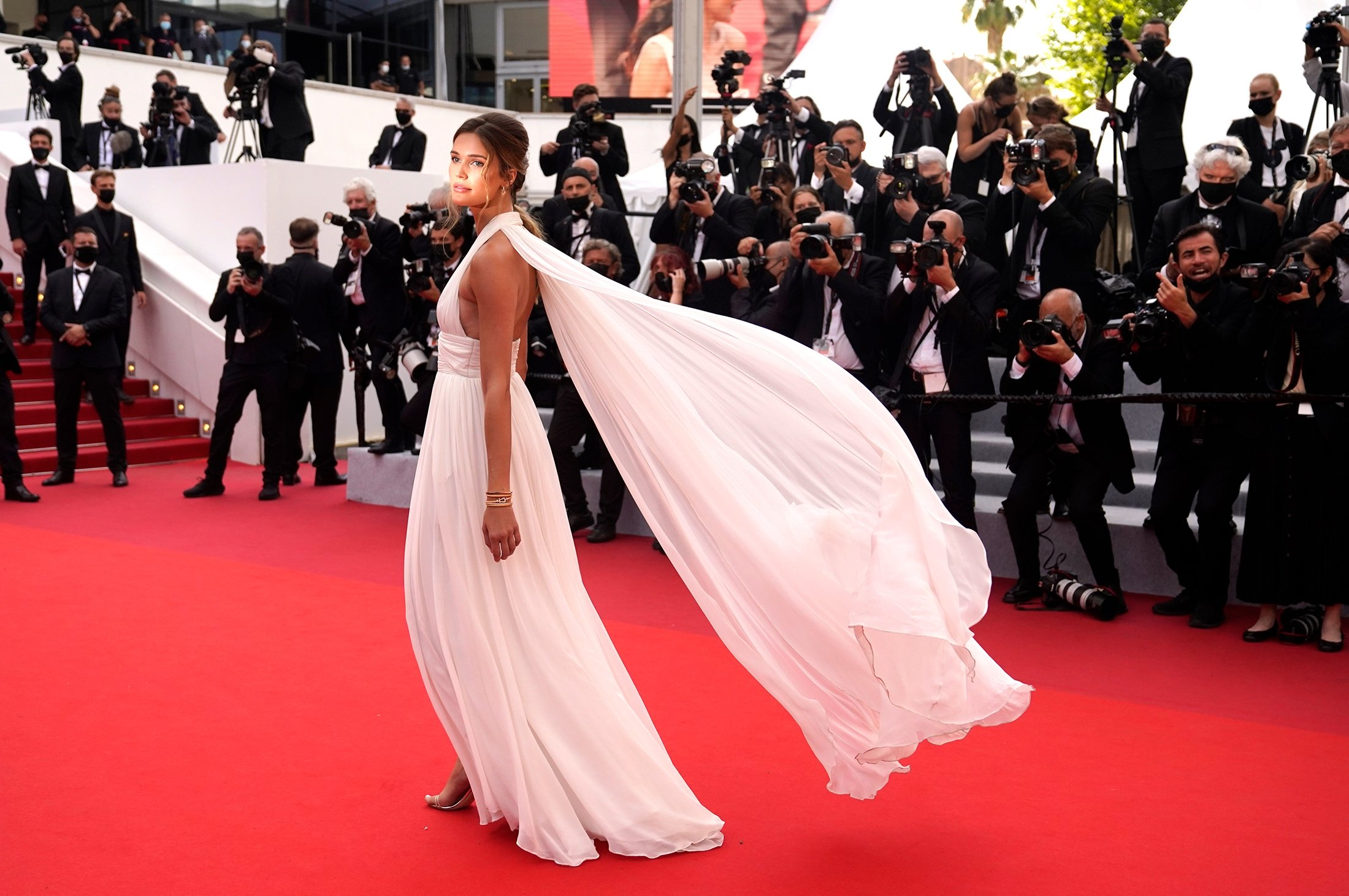 Noelle Capri poses for photographers upon arrival at the premiere of the film 'Everything Went Fine' at the 74th international film festival, Cannes, southern France, July 7, 2021. (AP Photo)