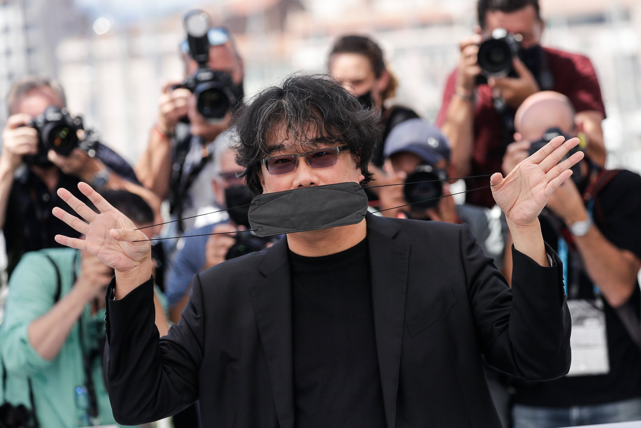 Director Bong Joon Ho poses for photographers at a photo call during the 74th international film festival, Cannes, southern France, July 7, 2021. (AP Photo)