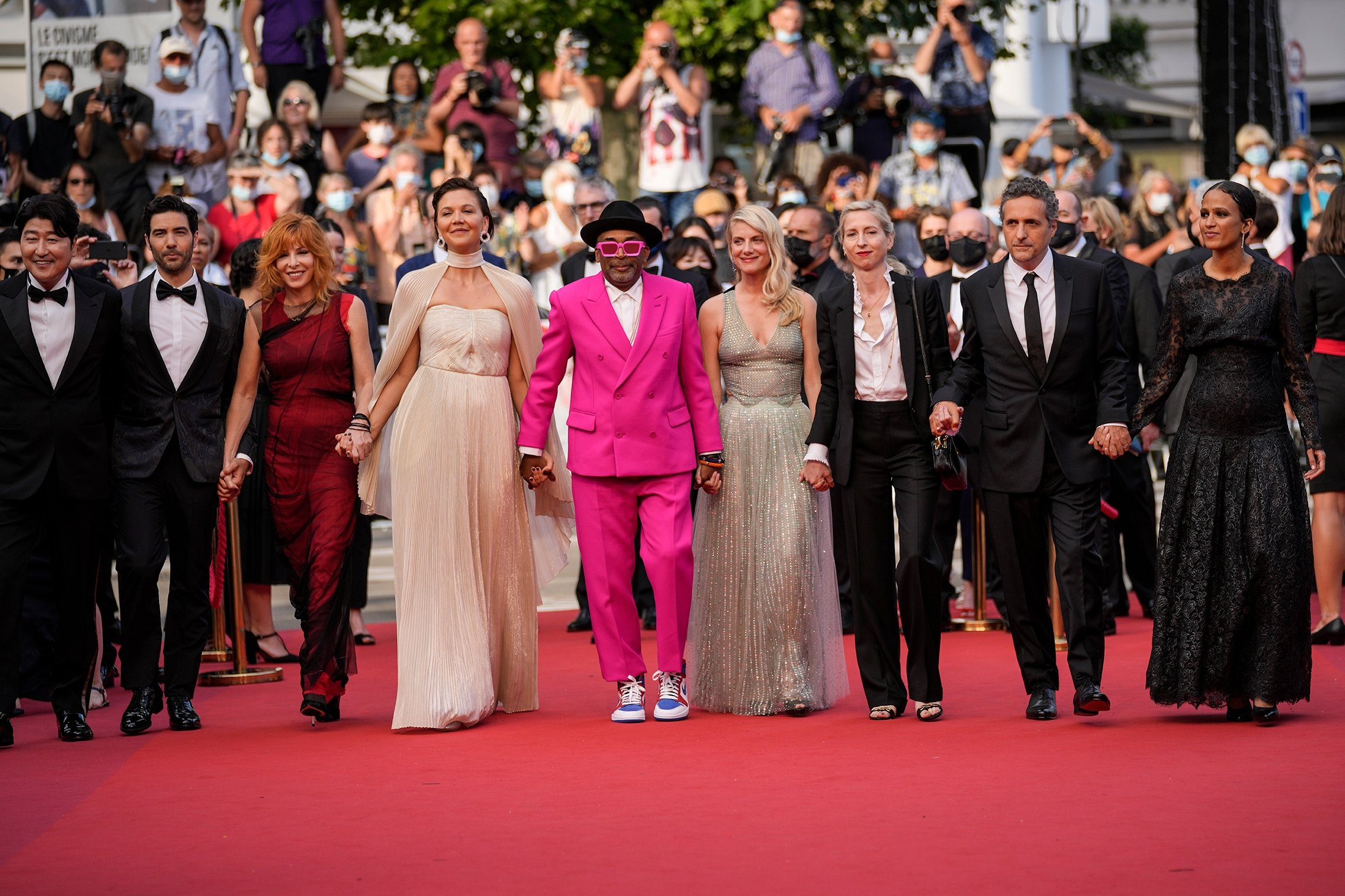 From left, jury members Kang-Ho Song, Tahar Rahim, Mylene Farmer, Maggie Gyllenhaal, Spike Lee, Melanie Laurent, Jessica Hausner, Kleber Mendonca Filho and Mati Diop pose for photographers upon arrival at the opening ceremony of the 74th international film festival, Cannes, southern France, July 6, 2021. (AP Photo)