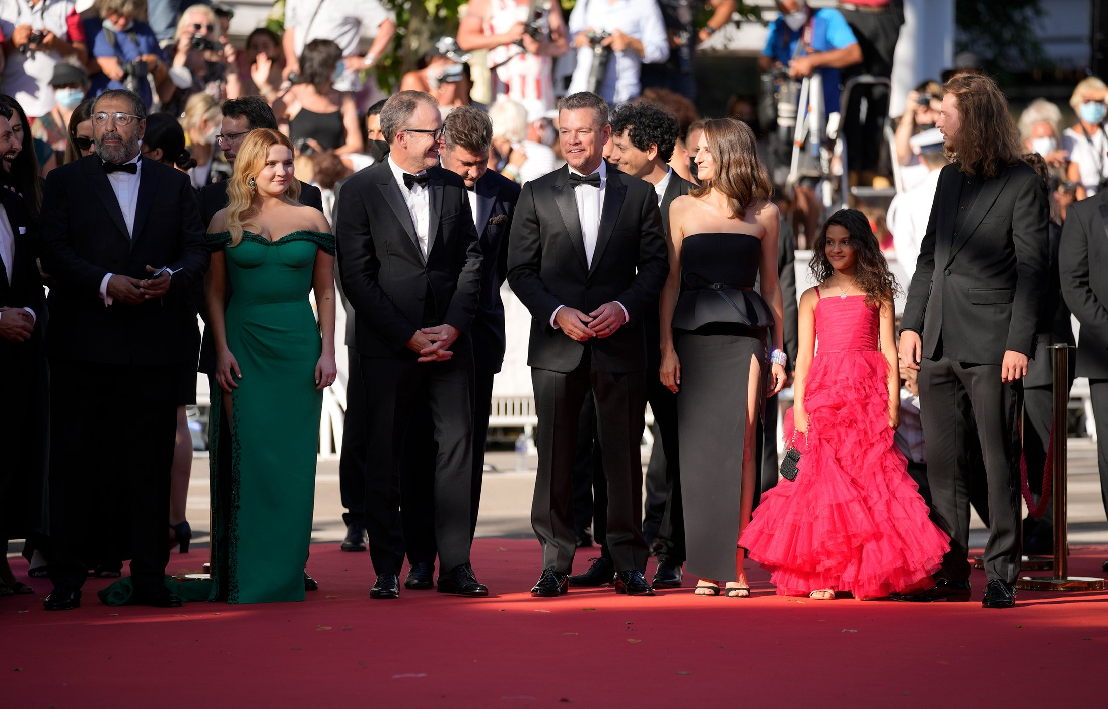 From left, Moussa Maaskri, Abigail Breslin, director Tom McCarthy, Thomas Bidegain, Matt Damon, Noe Debre, Camille Cottin, Lilou Siauvaud, and Idir Azougli pose for photographers upon arrival at the premiere of the film 'Stillwater' at the 74th international film festival, Cannes, southern France, July 8, 2021. (AP Photo)