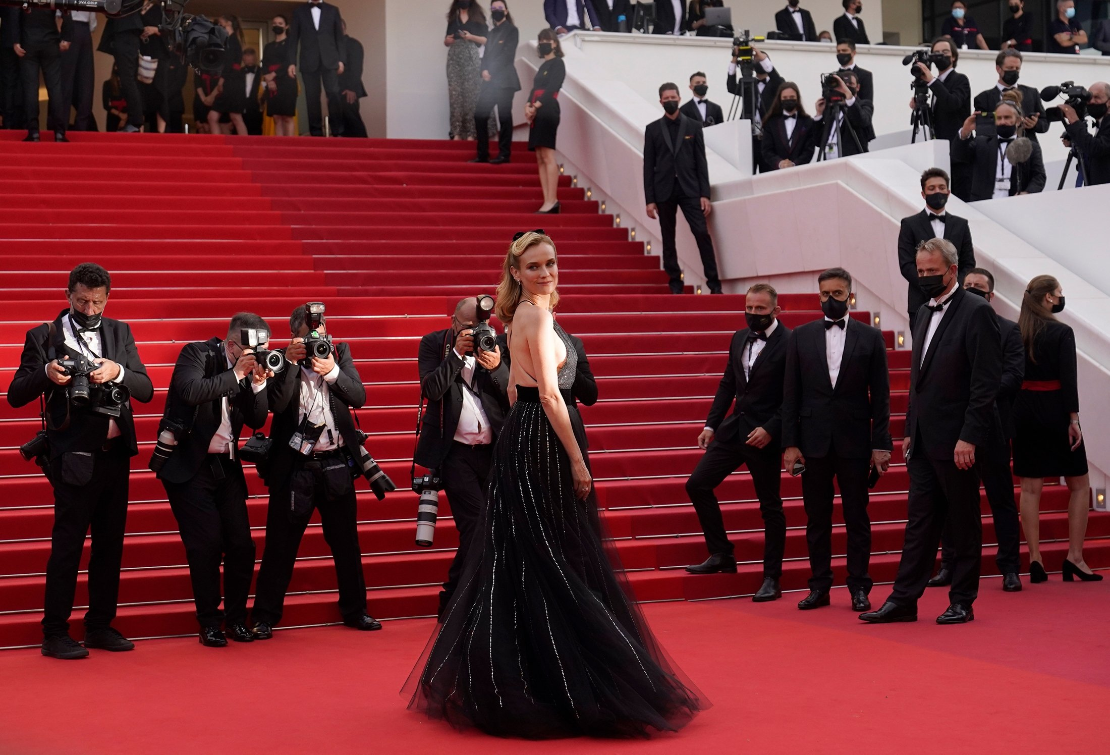 Diane Kruger poses for photographers upon arrival at the premiere of the film 'Everything Went Fine' at the 74th international film festival, Cannes, southern France, July 7, 2021. (AP Photo)