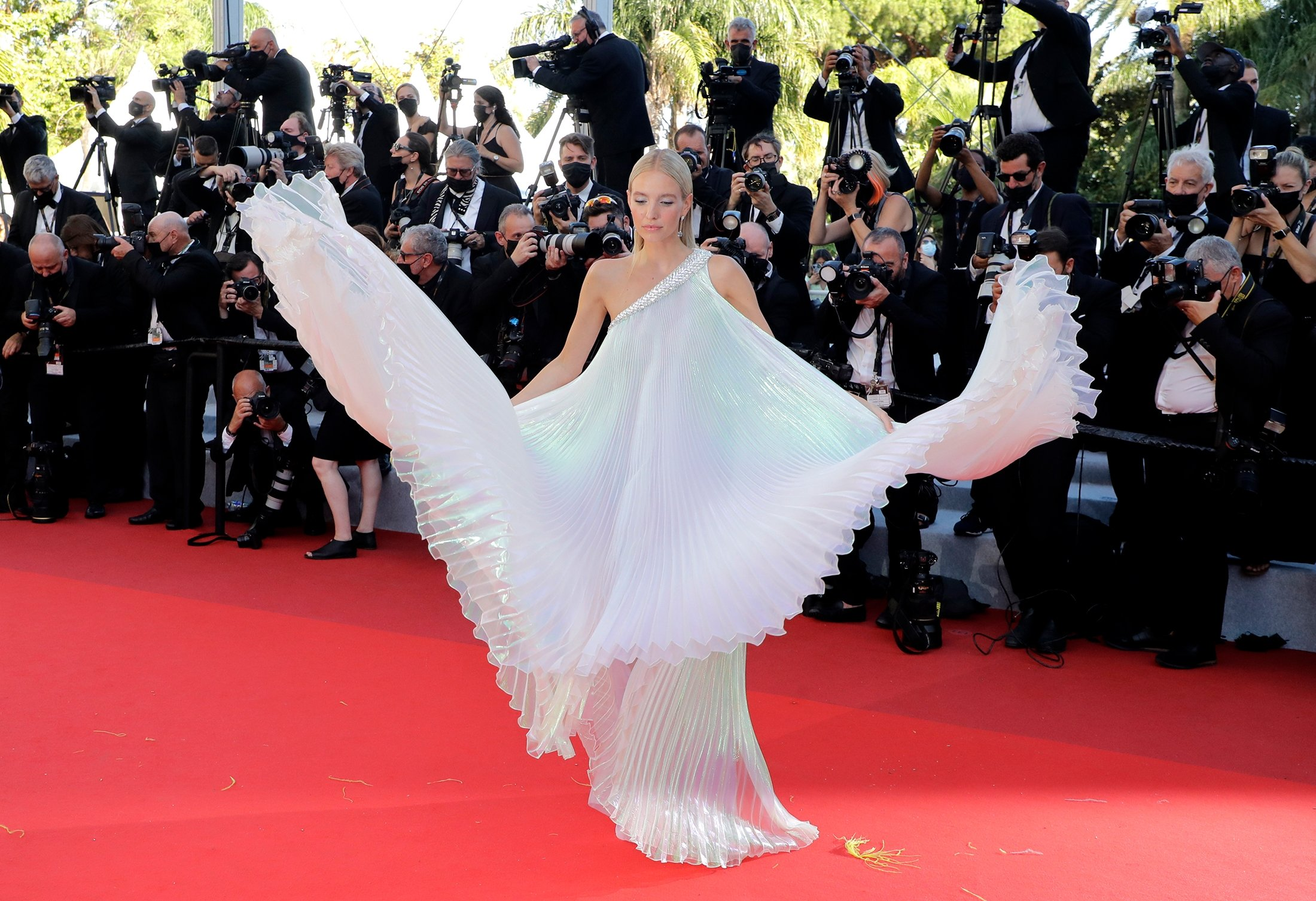 Leonie Hanne poses for photographers upon arrival at the premiere of the film 'Stillwater' at the 74th international film festival, Cannes, southern France, July 8, 2021. (AP Photo)