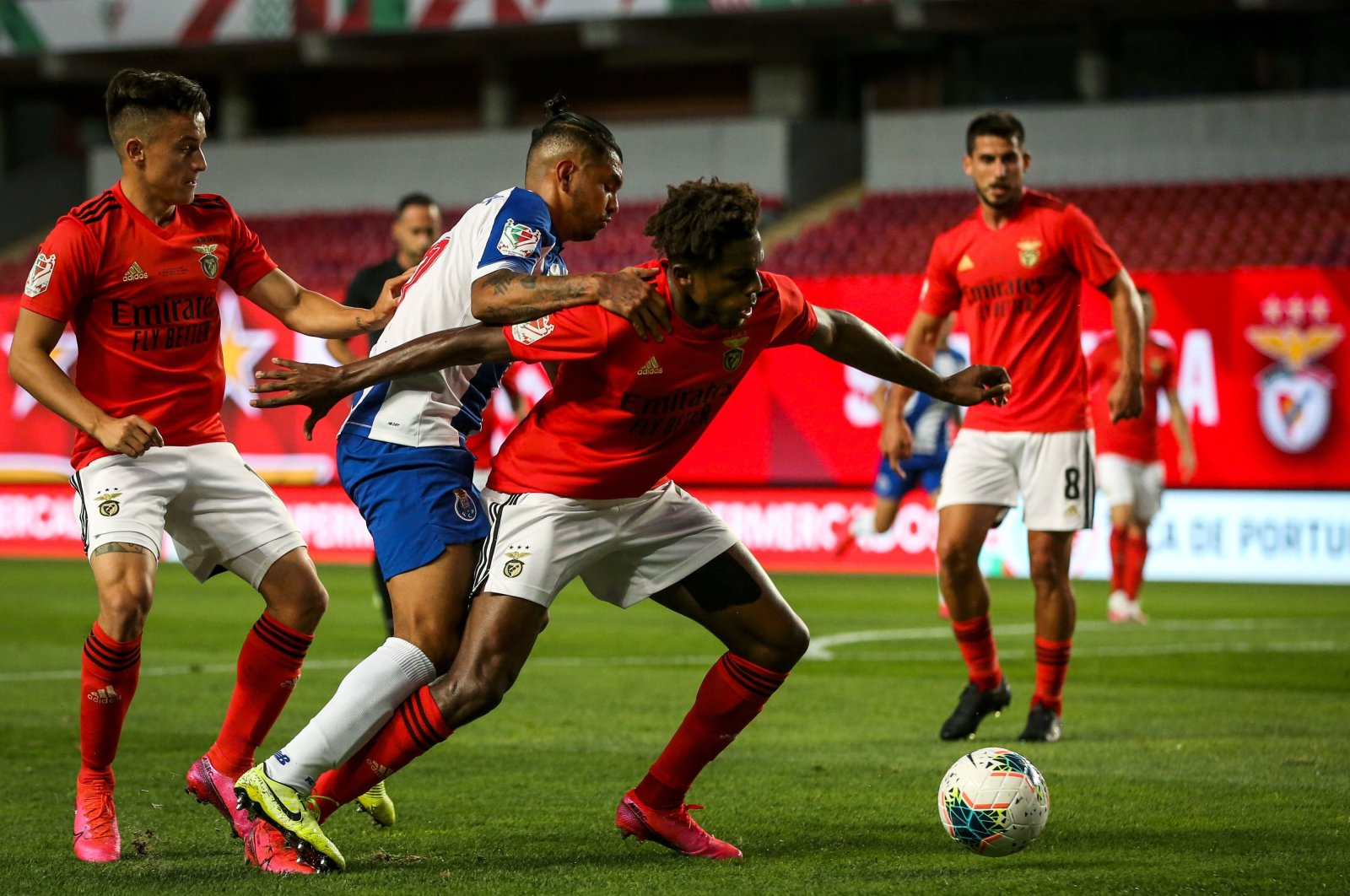 FC Porto's Mexican forward Jesus 'Tecatito' Corona (C) vies with Benfica's Argentinian forward Franco Cervi (L) and Benfica's Portuguese defender Nuno Tavares during the 'Taca de Portugal' (Portugal's Cup) final football match between SL Benfica and FC Porto at the City Stadium of Coimbra on August 1, 2020. (AFP Photo)