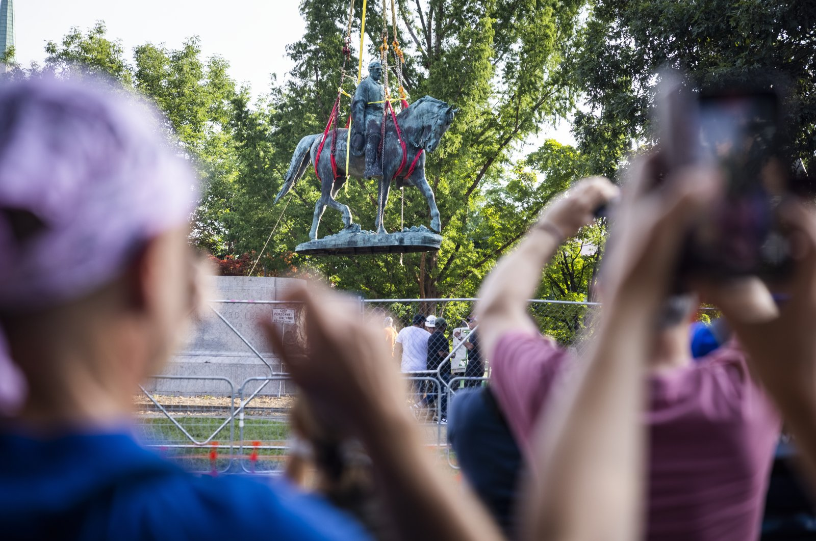 Workers remove the statue of Confederate General Robert E. Lee in Market Street Park in Charlottesville, Virginia, USA, July 10, 2021. (EPA Photo)