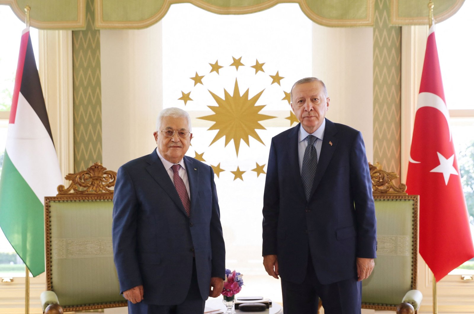 A handout picture taken and released by the Turkish Presidential press office on July 10, 2021 shows Turkish President Recep Tayyip Erdoğan (R) meeting with Palestinian President Mahmoud Abbas (L) in Istanbul. (Turkish Presidency via AFP)