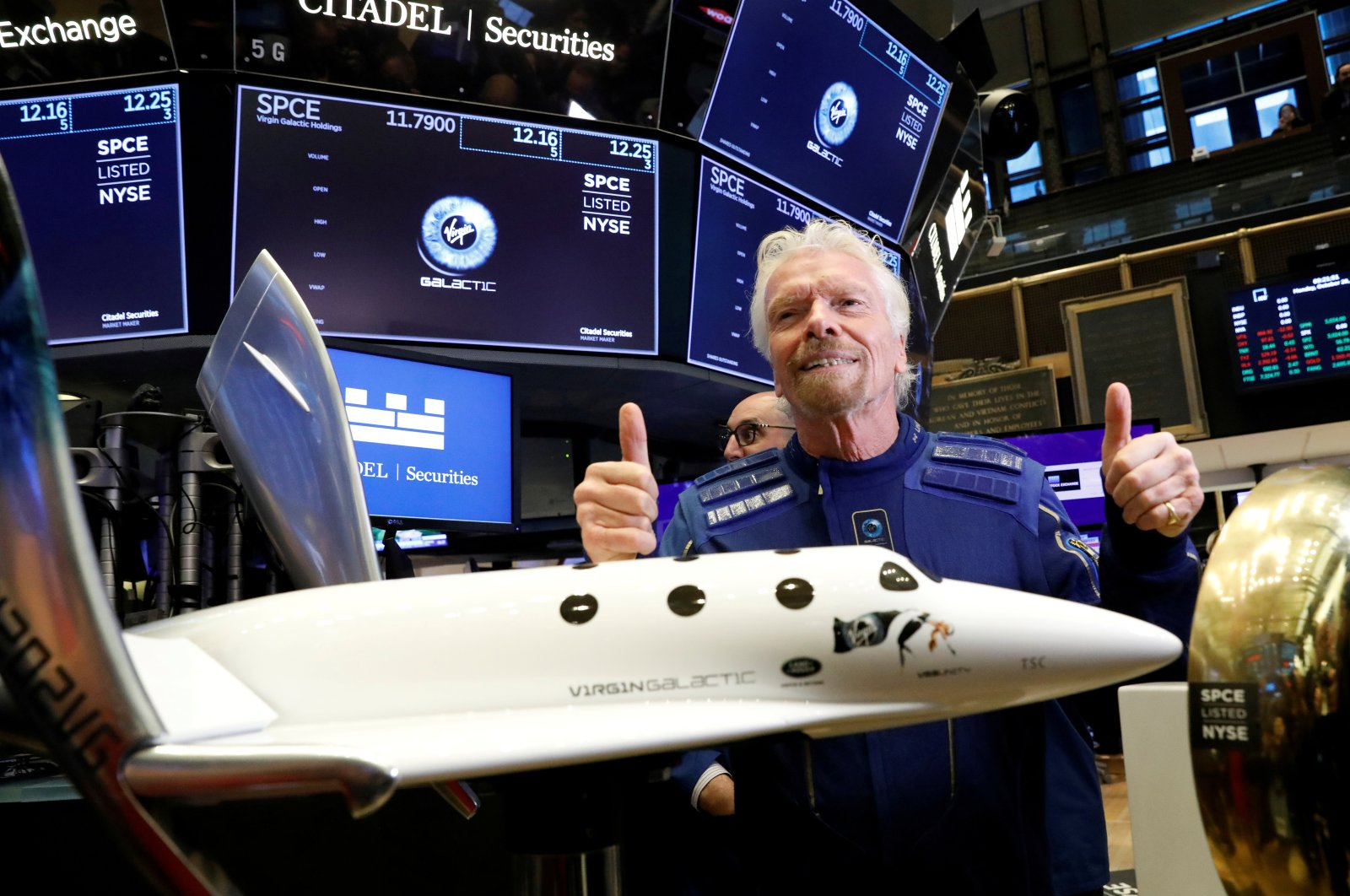 Sir Richard Branson poses on the floor of the New York Stock Exchange (NYSE) ahead of Virgin Galactic (SPCE) trading in New York, U.S., Oct. 28, 2019. (Reuters Photo)