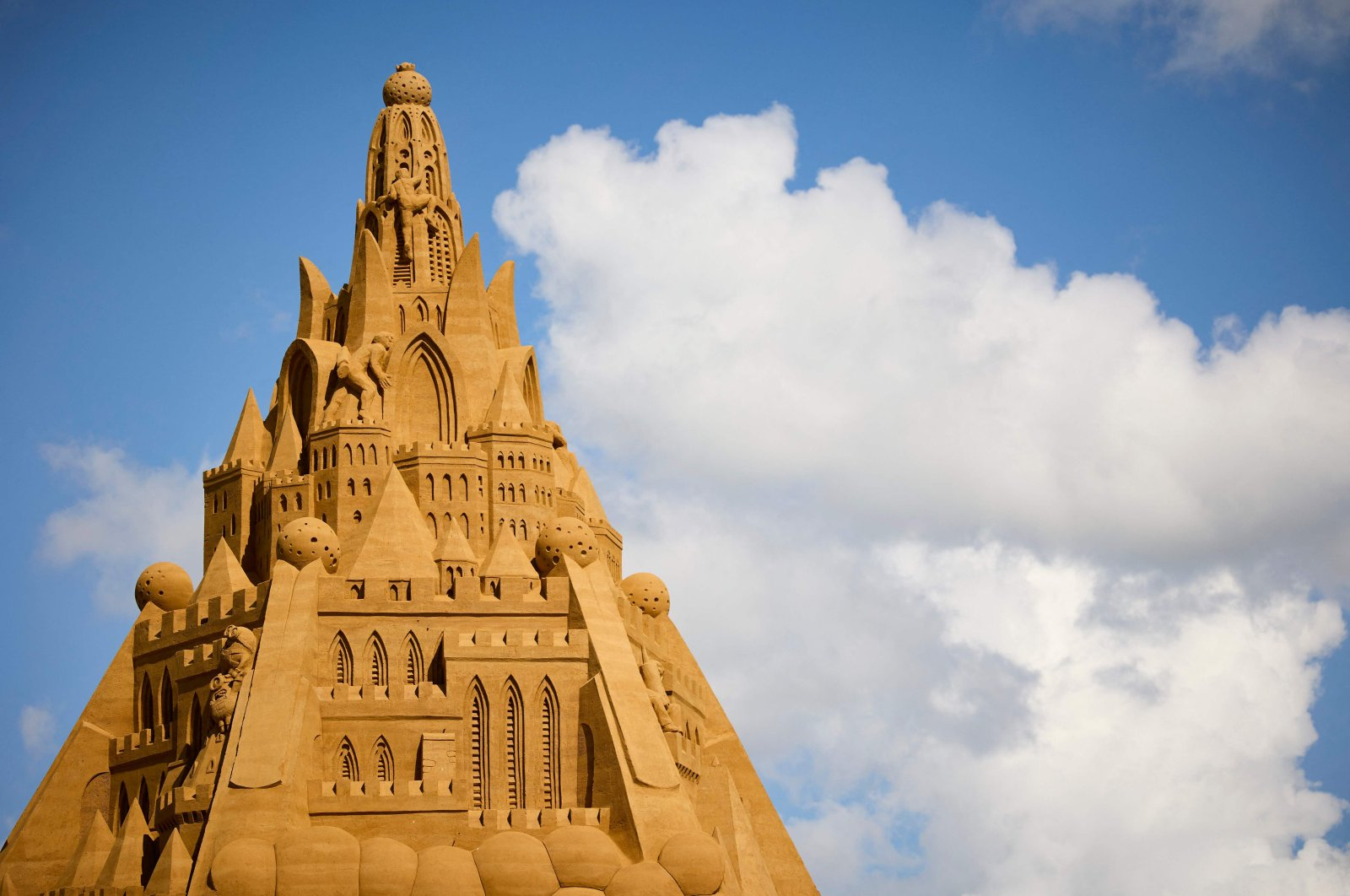 The world's tallest sand sculpture is under construction in Blokhus, Denmark, July 7, 2021. (AFP Photo)