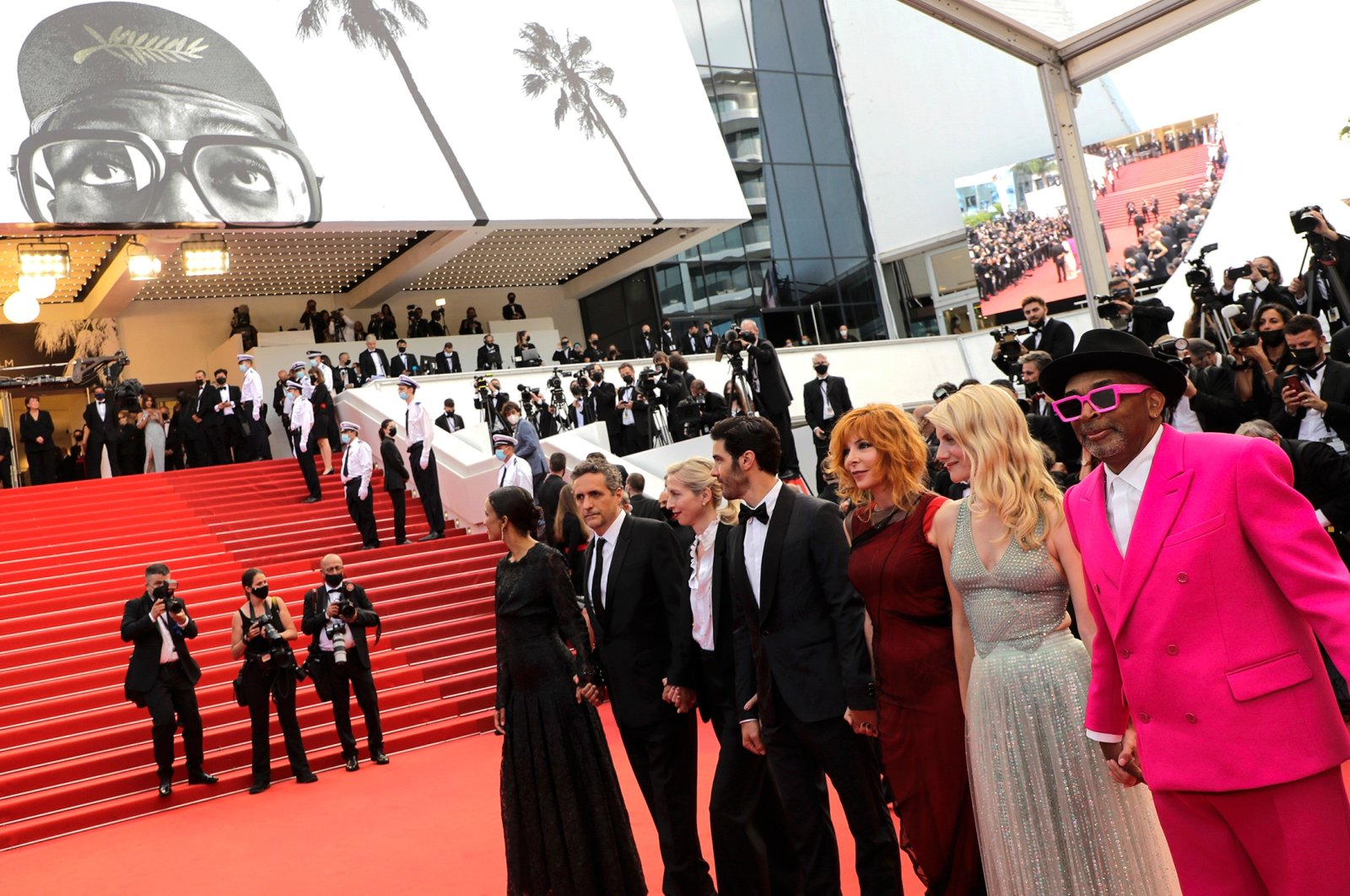 From left, jury members Mati Diop, Kleber Mendonca Filho, Jessica Hausner, Tahar Rahim, Mylene Farmer, Melanie Laurent, and Spike Lee pose for photographers upon arrival at the opening ceremony of the 74th international film festival, Cannes, southern France, July 6, 2021. (AP Photo)