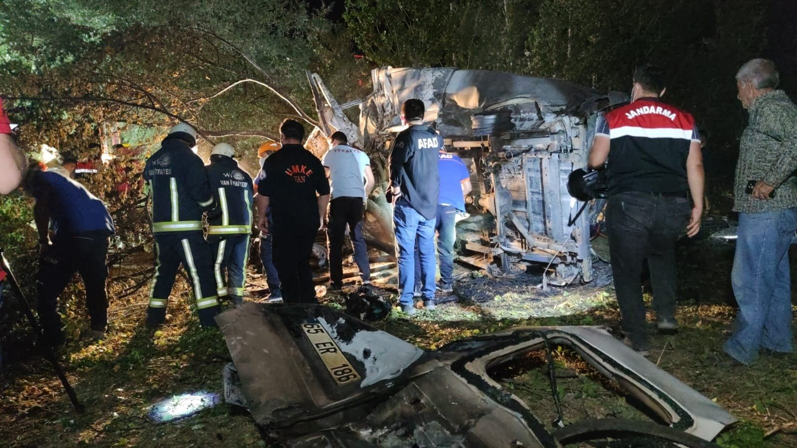 Rescue personnel and security forces inspect the crash scene in Van, Turkey, July 11, 2021. (IHA Photo)