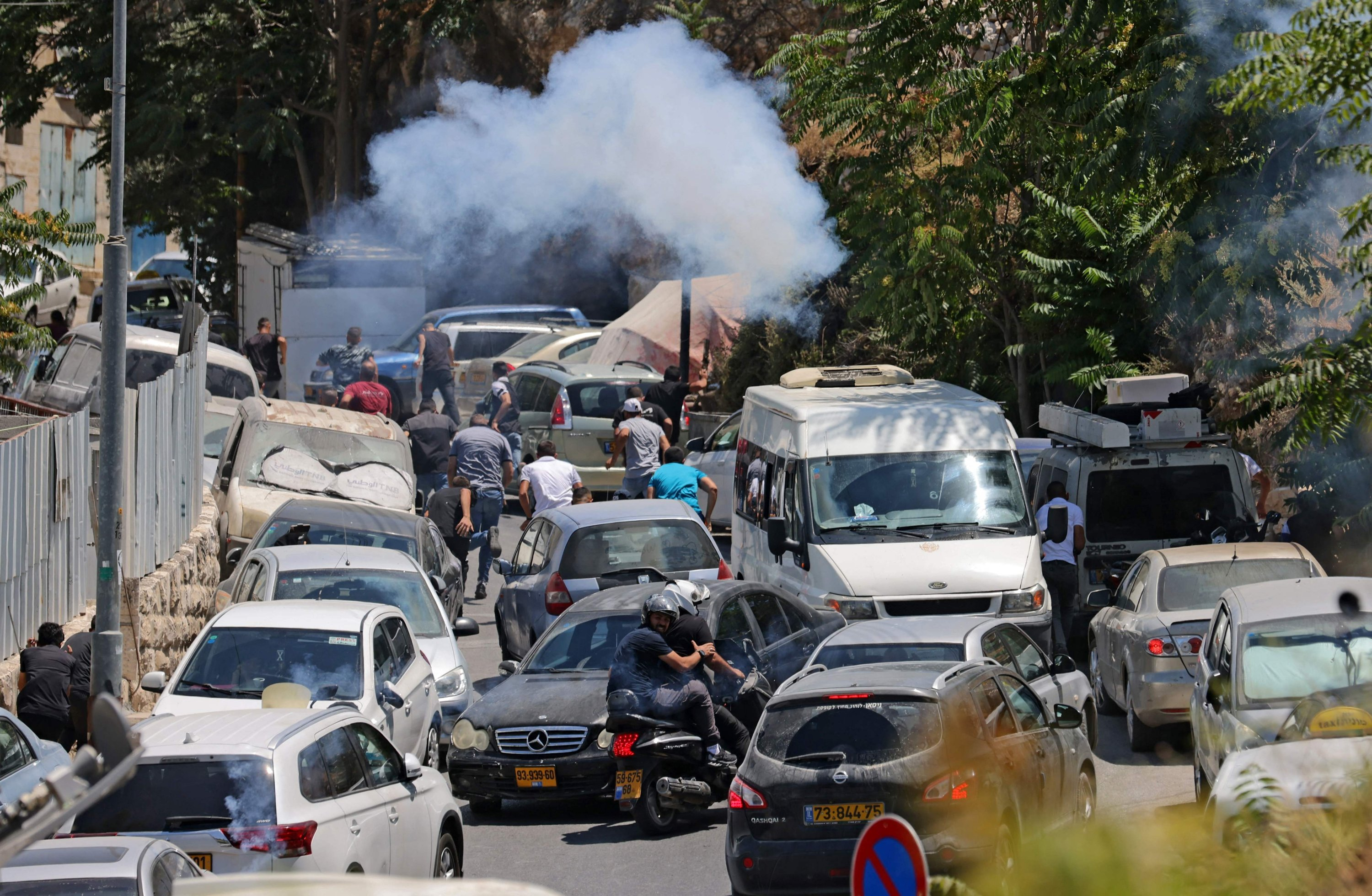 Smoke billows during clashes between Israeli security and Palestinians following Friday prayers in Silwan, East Jerusalem, July 2, 2021. (AFP Photo)