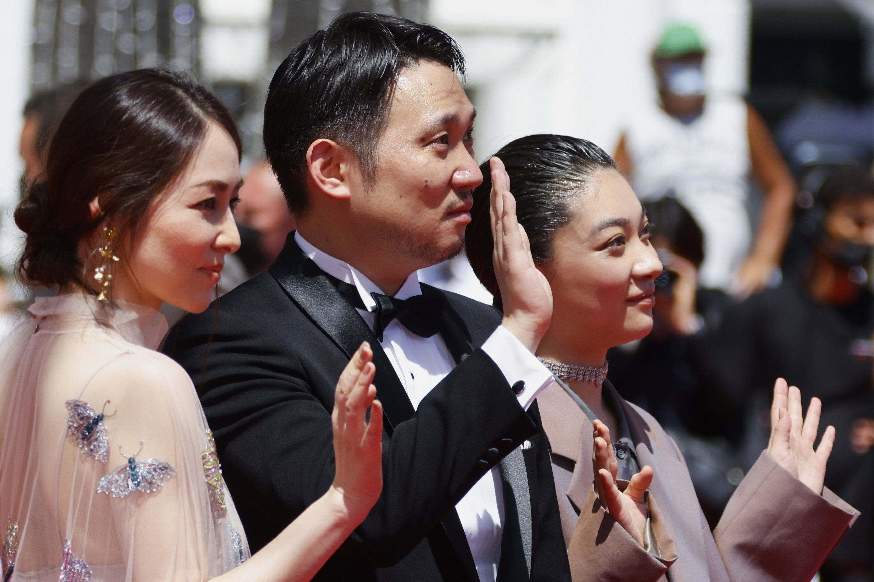 Director Ryusuke Hamaguchi (C), cast members Toko Miura (R)and Sonia Yuan pose during a photocall for the film 'Doraibu mai ka' (Drive My Car) at the 74th Cannes Film Festival in Cannes, France, July 11, 2021. (Reuters Photo)