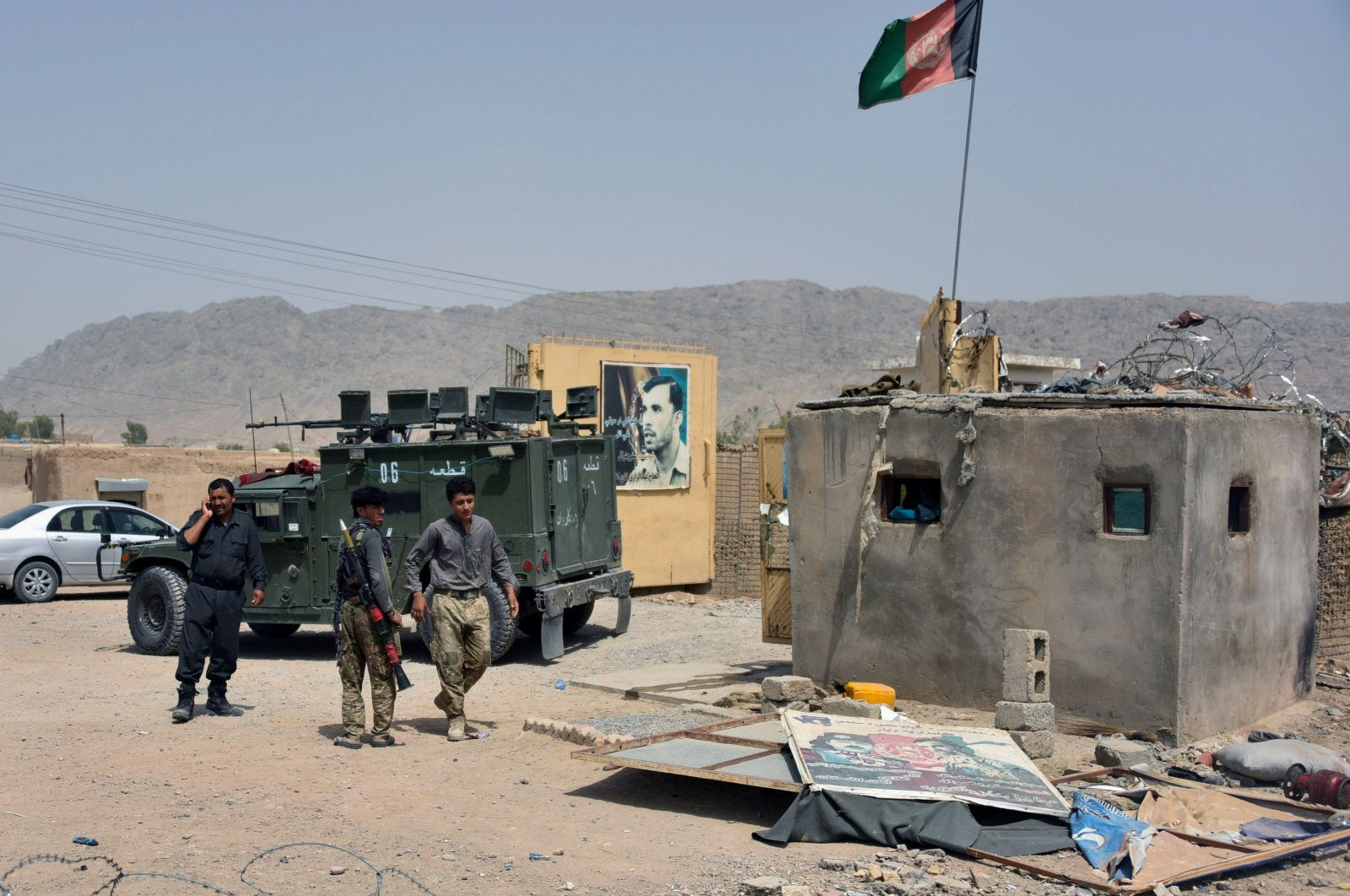 Afghan security forces inspect the site of a car bomb attack in Kandahar province, Afghanistan, July 6, 2021. (Reuters Photo)
