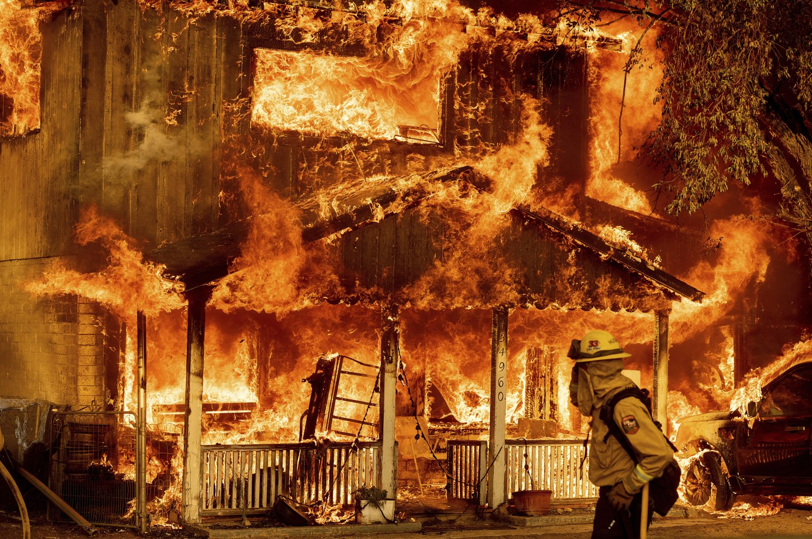 Fire consumes a home as the Sugar Fire, part of the Beckwourth Complex Fire, tears through Doyle, California, U.S., July 10, 2021. (AP Photo)