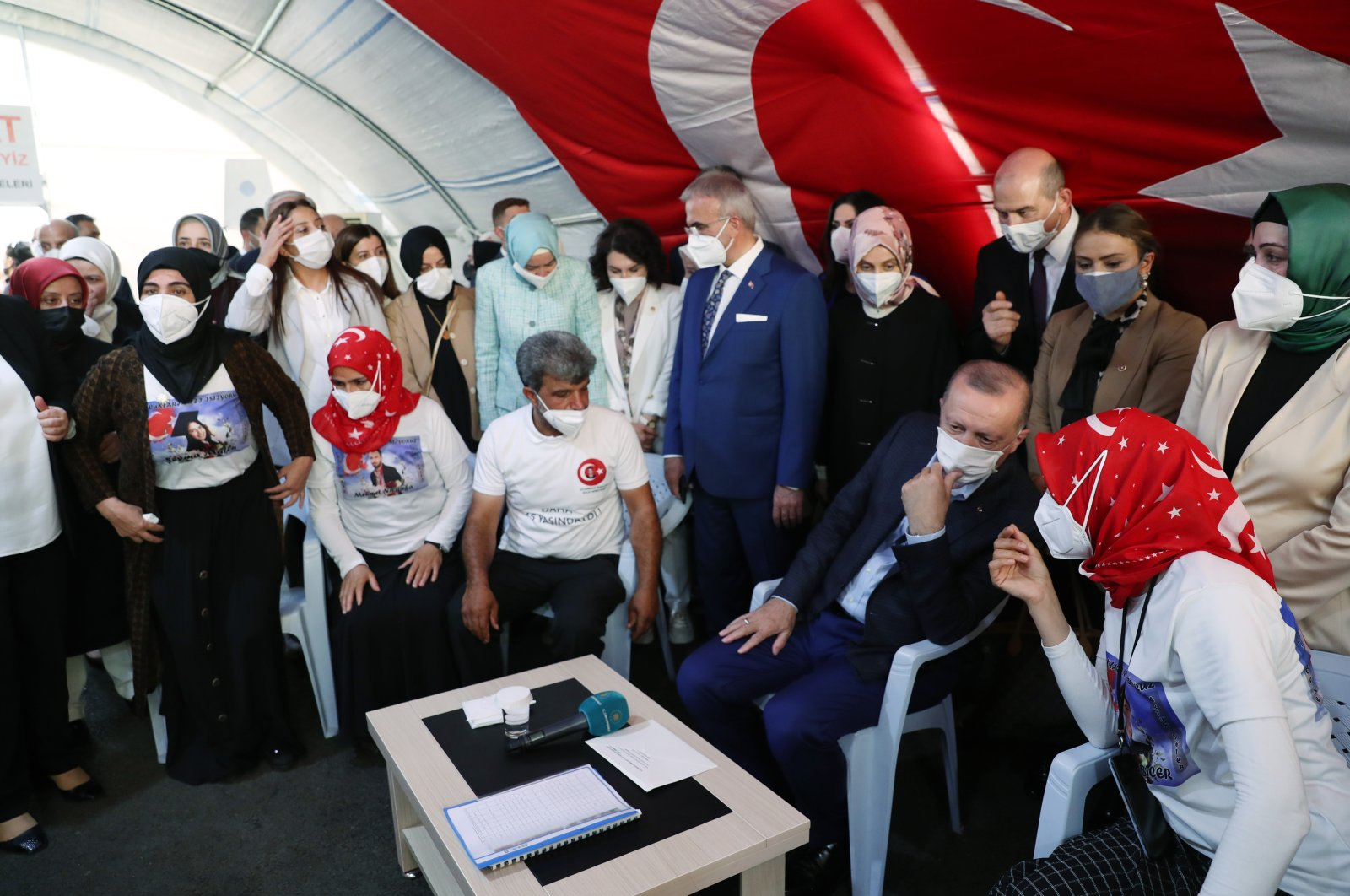 President Recep Tayyip Erdoğan visits families who have been staging a sit-in protest against the PKK terrorist group in southeastern Diyarbakır province, Turkey, July 9, 2021. (AA Photo)