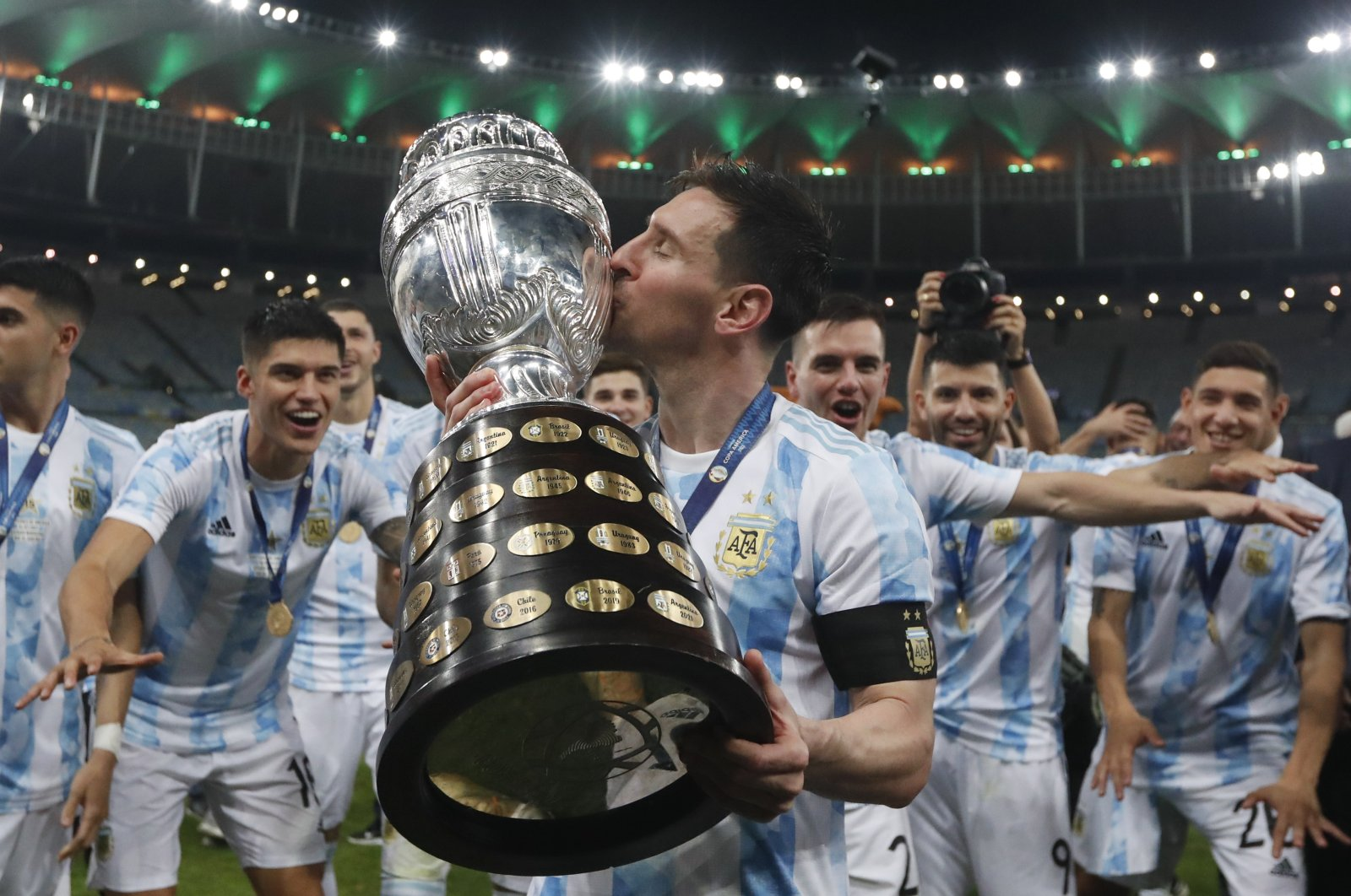 Argentina's Lionel Messi kisses the trophy after beating Brazil 1-0 in the Copa America final match at Maracana stadium in Rio de Janeiro, Brazil, July 10, 2021. (AP Photo)