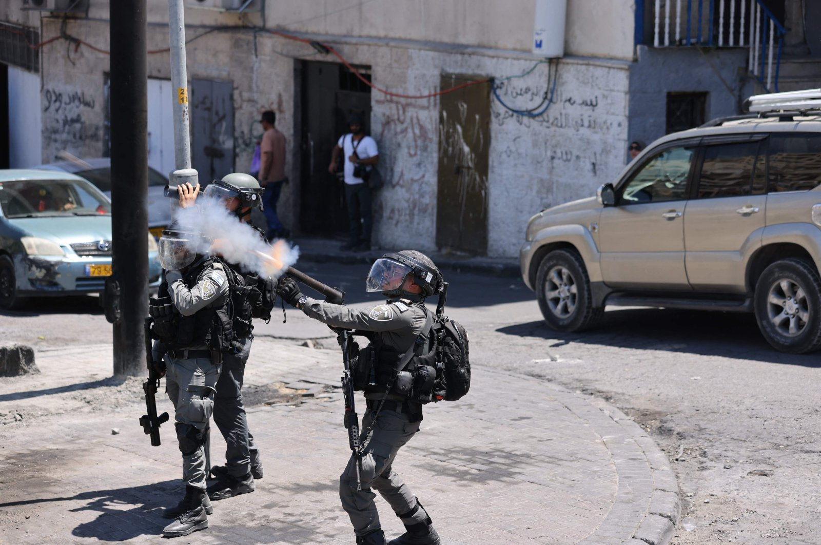 Israeli security forces disperse Palestinians during clashes following Friday prayers, in Silwan, East Jerusalem, on July 2, 2021. (AFP Photo)