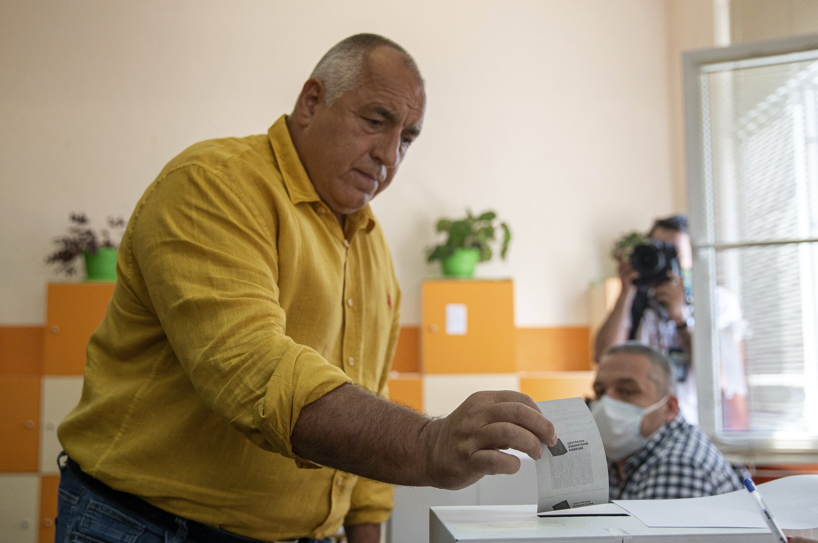 Bulgarian former prime minister Boyko Borissov casts his vote during parliamentary elections in the town of Bankya near capital Sofia, Bulgaria on Sunday, July 11, 2021. (AP Photo)