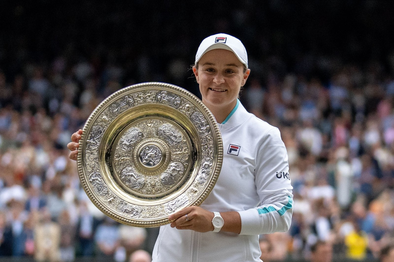 Australia's Ashleigh Barty poses as she celebrates with the trophy after winning the Wimbledon final against Czech Republic's Karolina Pliskova, All England Tennis Club, London, England, July 10, 2021.