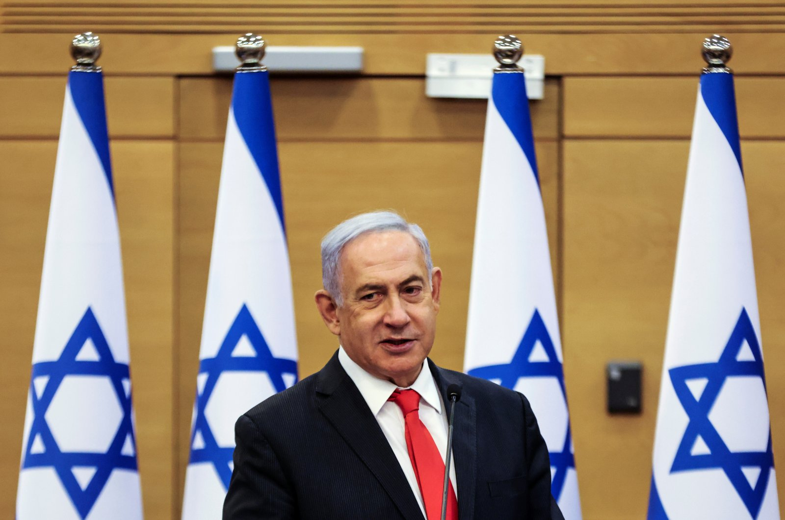 Leader of Israeli opposition Benjamin Netanyahu speaks during a meeting with his Likud party at the Israeli Parliament, in West Jerusalem, Israel, June 14, 2021. (Reuters Photo)
