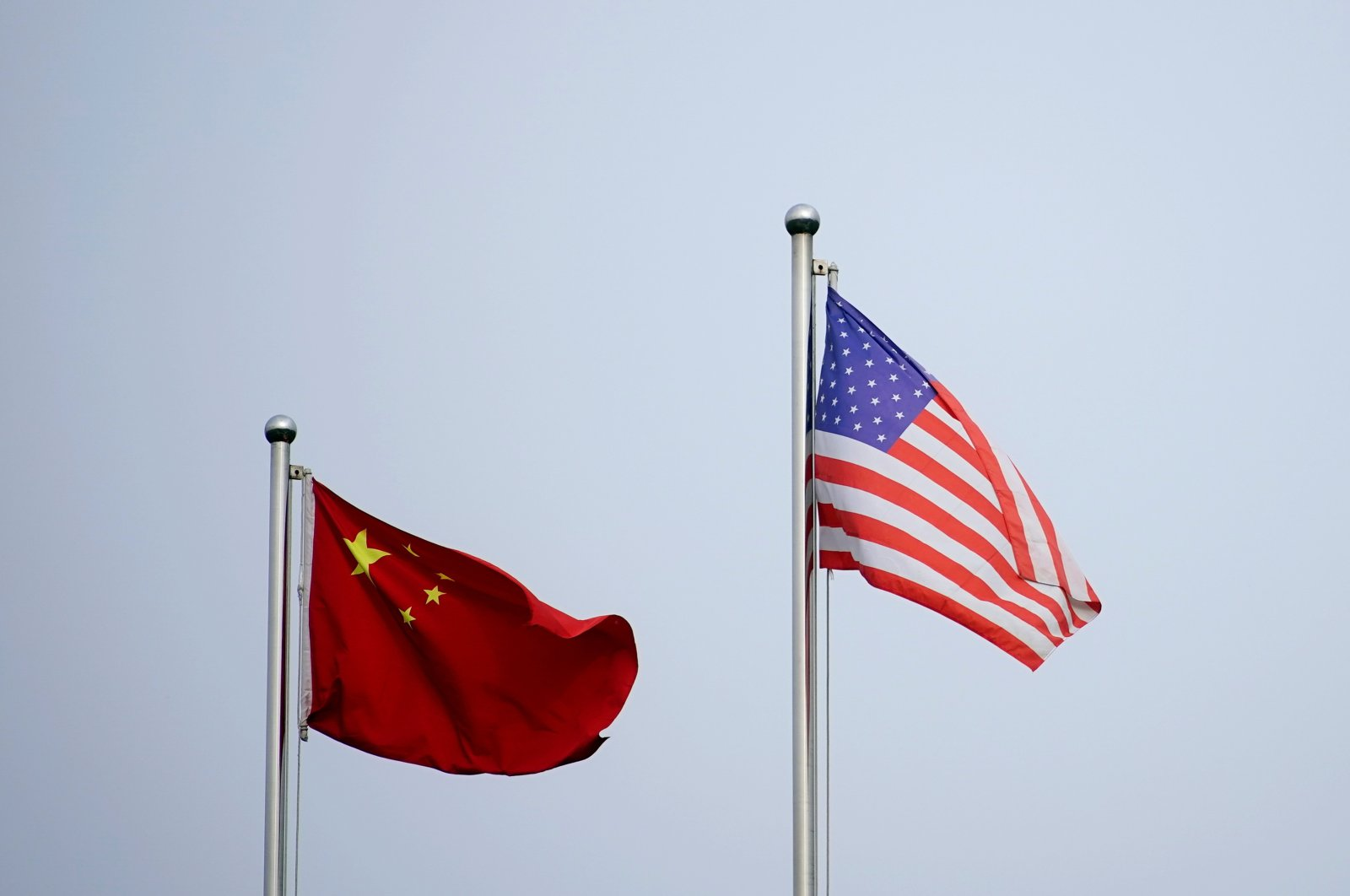 Chinese and U.S. flags flutter outside a company building in Shanghai, China, April 14, 2021. (Reuters Photo)