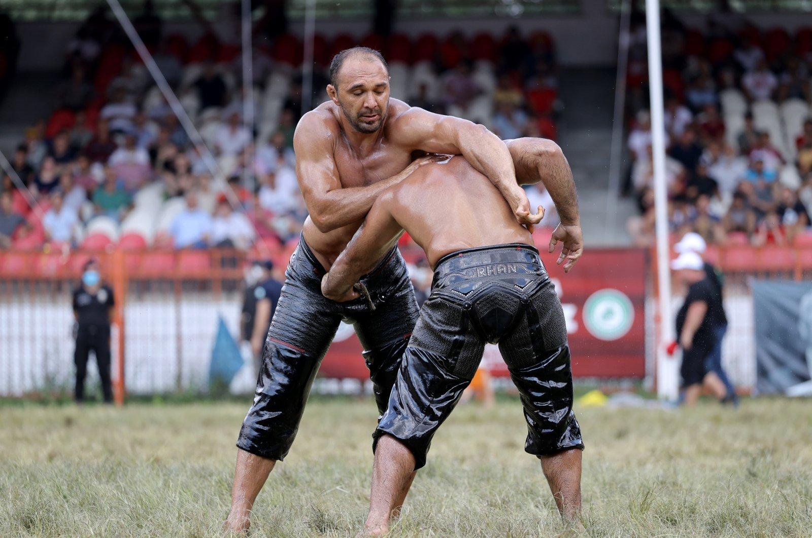 Ali Gürbüz (left) wrestles with Orhan Okulu in the semi-finals at the 660th Historical Kırkpınar Oil Wrestling Festival in Turkey's Edirne province, July 11, 2021. (AA Photo)