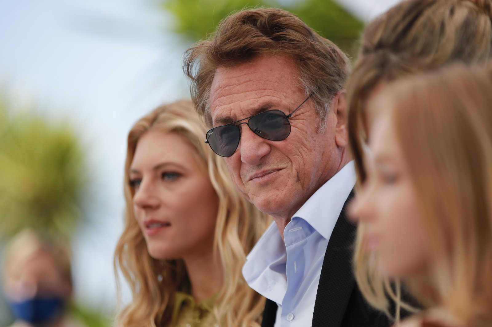 """Director Sean Penn (C)and cast member Katheryn Winnick (L) pose during aphotocall for the film """"Flag Day"""" at the74th Cannes Film Festival inCannes, France, July 11, 2021. (Reuters Photo)"""