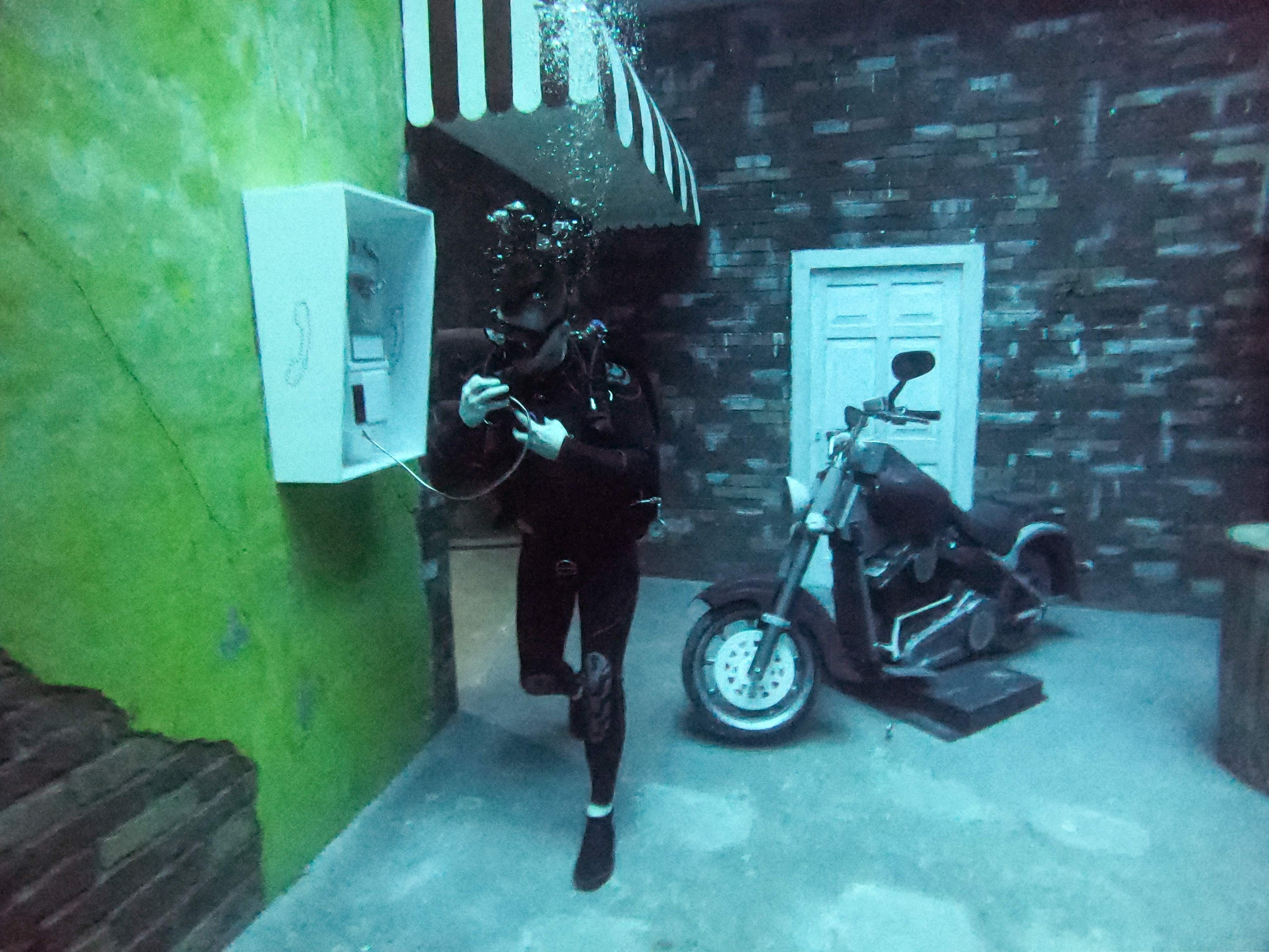 A diver uses a mock public phone as he experiences Deep Dive Dubai, the deepest swimming pool in the world reaching 60 meters (nearly 200 feet), in the United Arab Emirates, July 10, 2021. (AFP Photo)