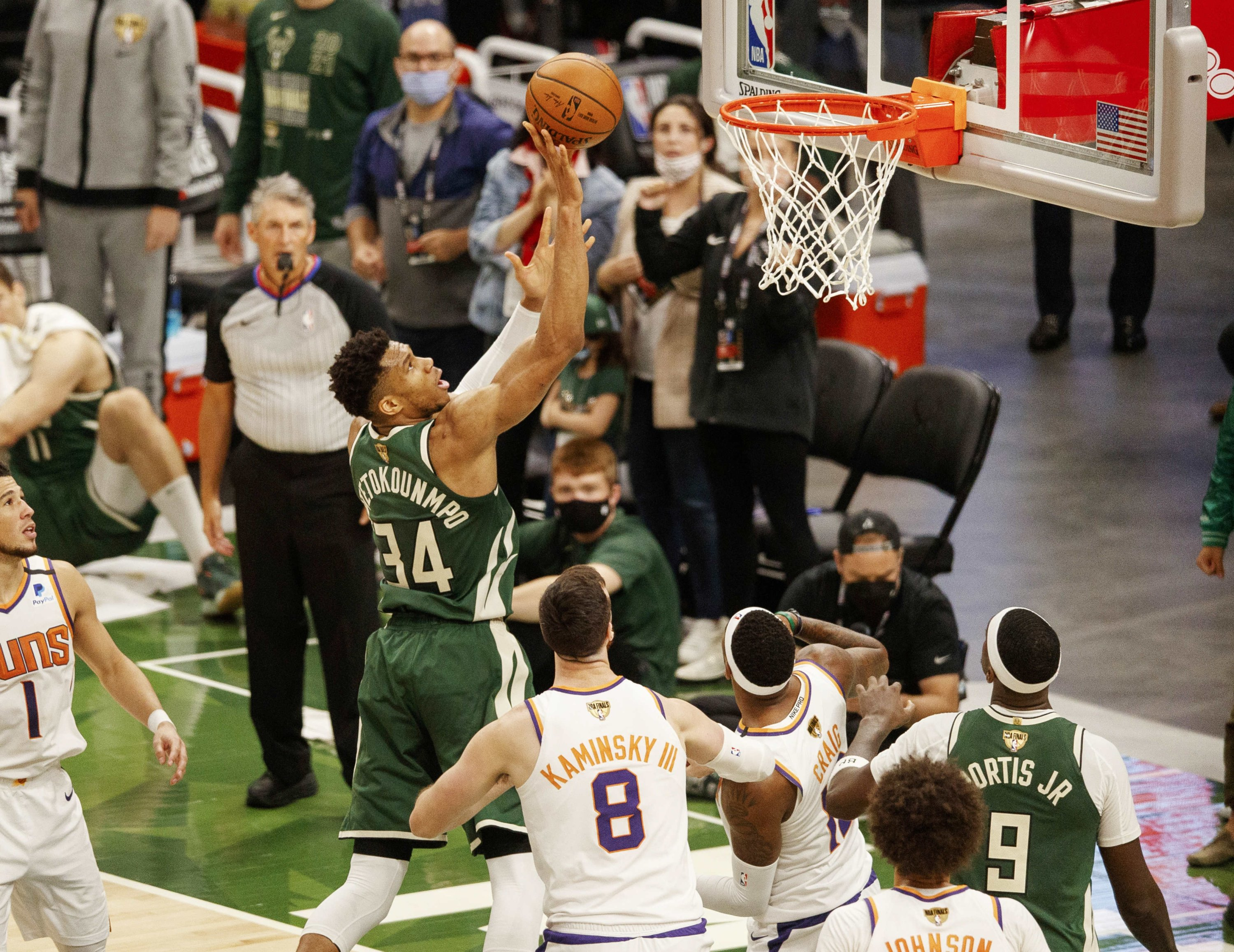 Milwaukee Bucks forward Giannis Antetokounmpo (2nd L) shoots against the Phoenix Suns during the NBA Finals Game 3 at Fiserv Forum, Milwaukee, Wisconsin, U.S., July 11, 2021. (Reuters Photo)