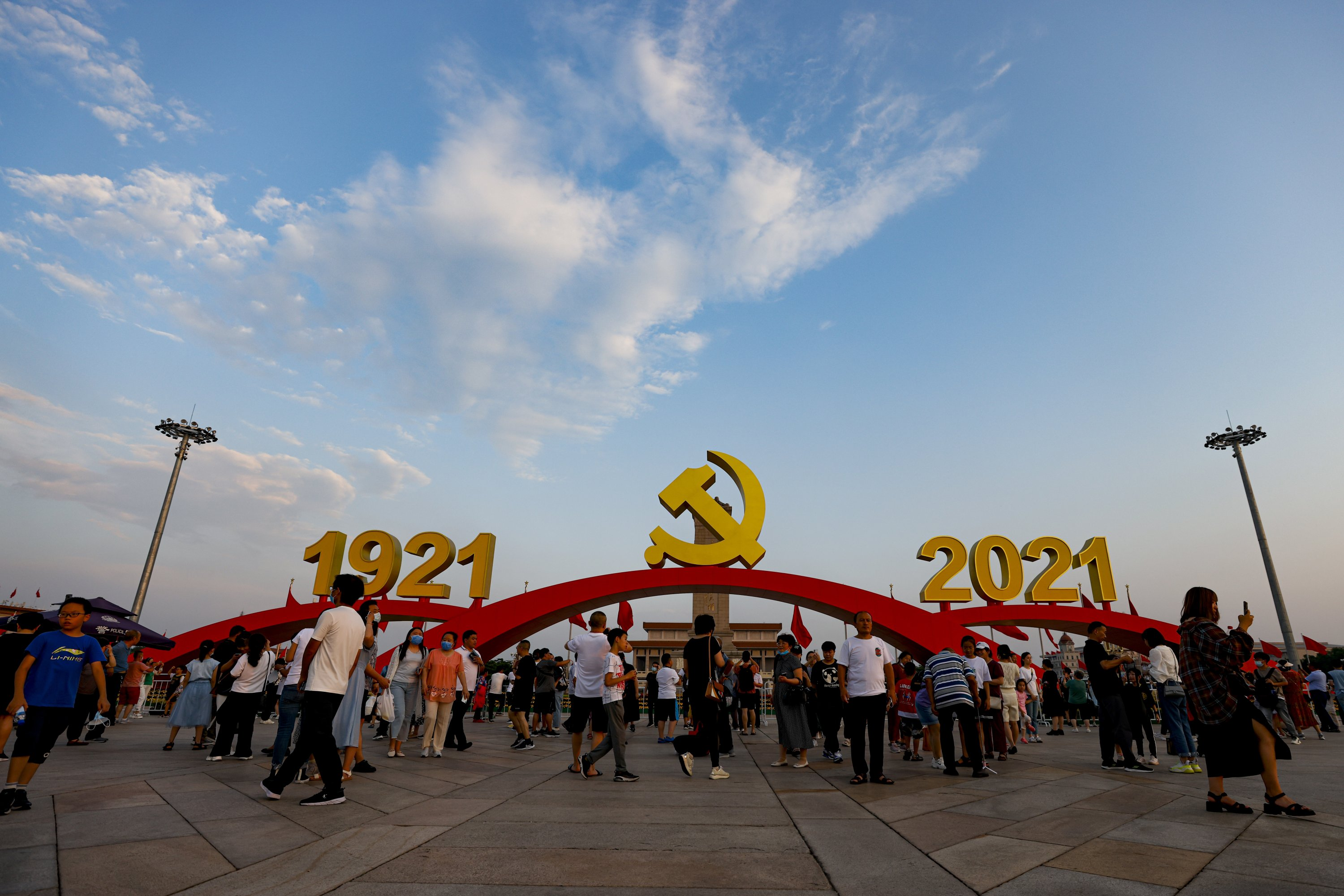 Tourists pose for photos in front of an art installation marking the 100th anniversary of the founding of the Communist Party of China (CPC) at Tiananmen Square in Beijing, China, July 9, 2021. (Getty Images)