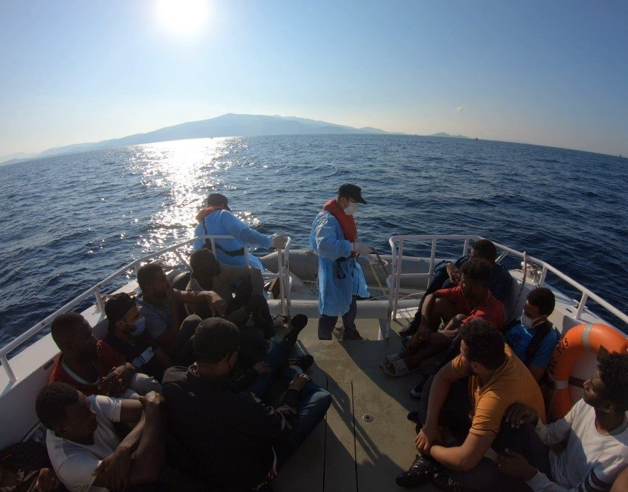 A group of 15 irregular migrants was rescued off the coast of Izmir province's Dikili district, Turkey, July 9, 2021. (AA Photo)