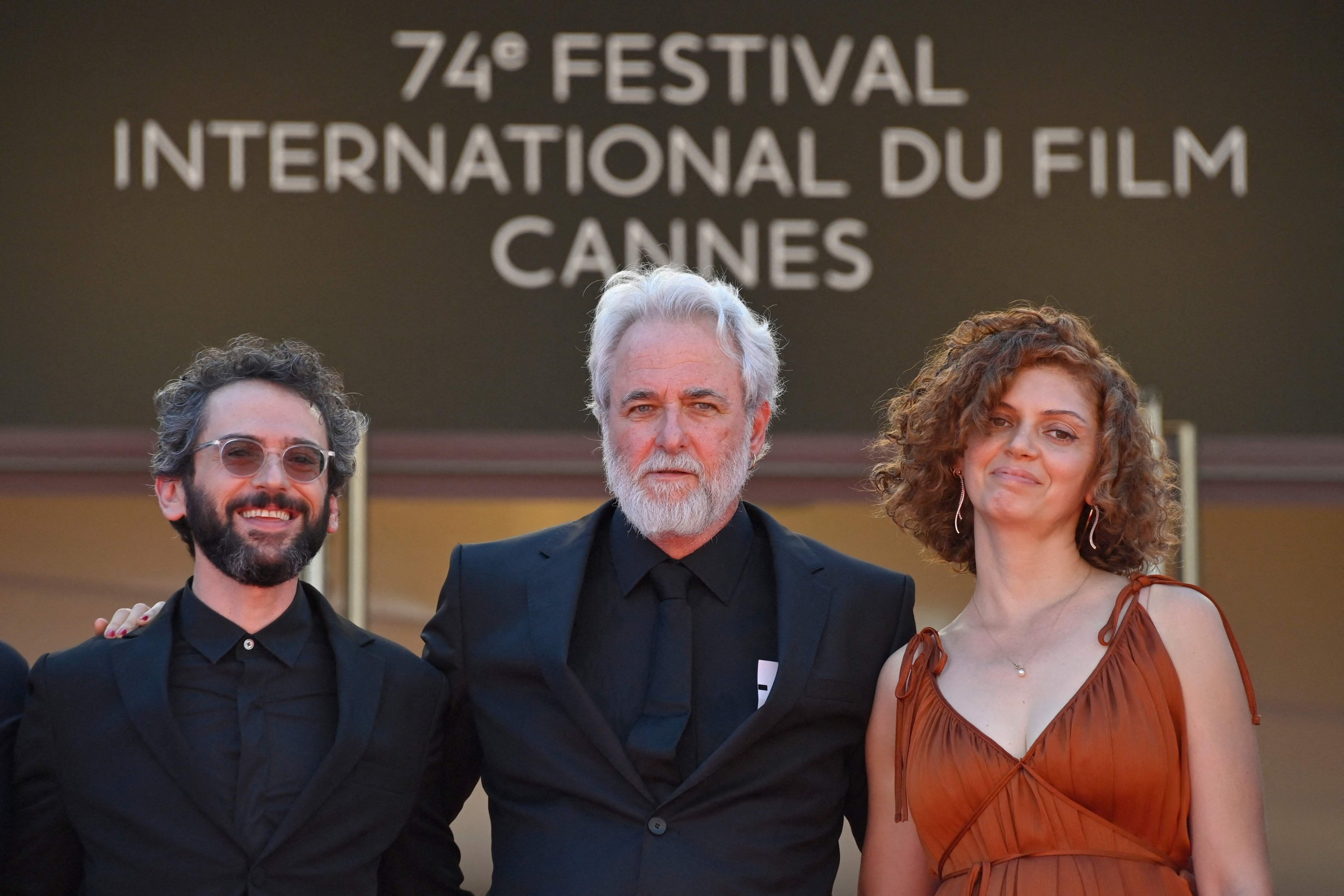 """Director Ari Folman (C) arrives with musician Ben Goldwasser (L) and comic strip writer Lena Guberman for the screening of the film """"Where Is Anne Frank"""" at the 74th Cannes Film Festival in Cannes, France, July 9, 2021. (AFP Photo)"""