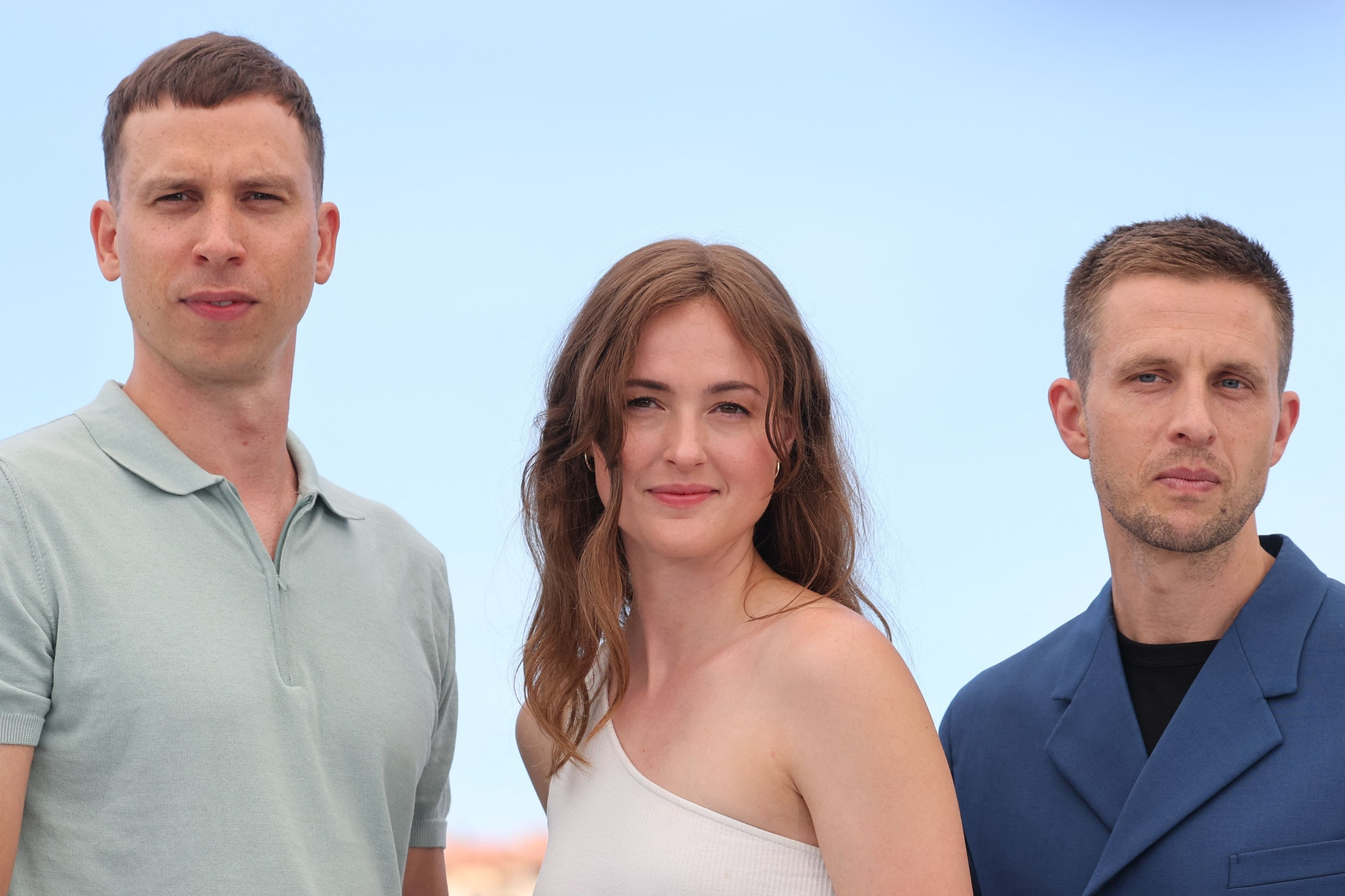 """Norwegian actors Herbert Nordrum (L), Renate Reinsve (C) and Anders Danielsen Lie pose during a photocall for the film """"Verdens Verste Menneske"""" (The Worst Person In The World) at the 74th Cannes Film Festival in Cannes, France, July 9, 2021. (AFP)"""