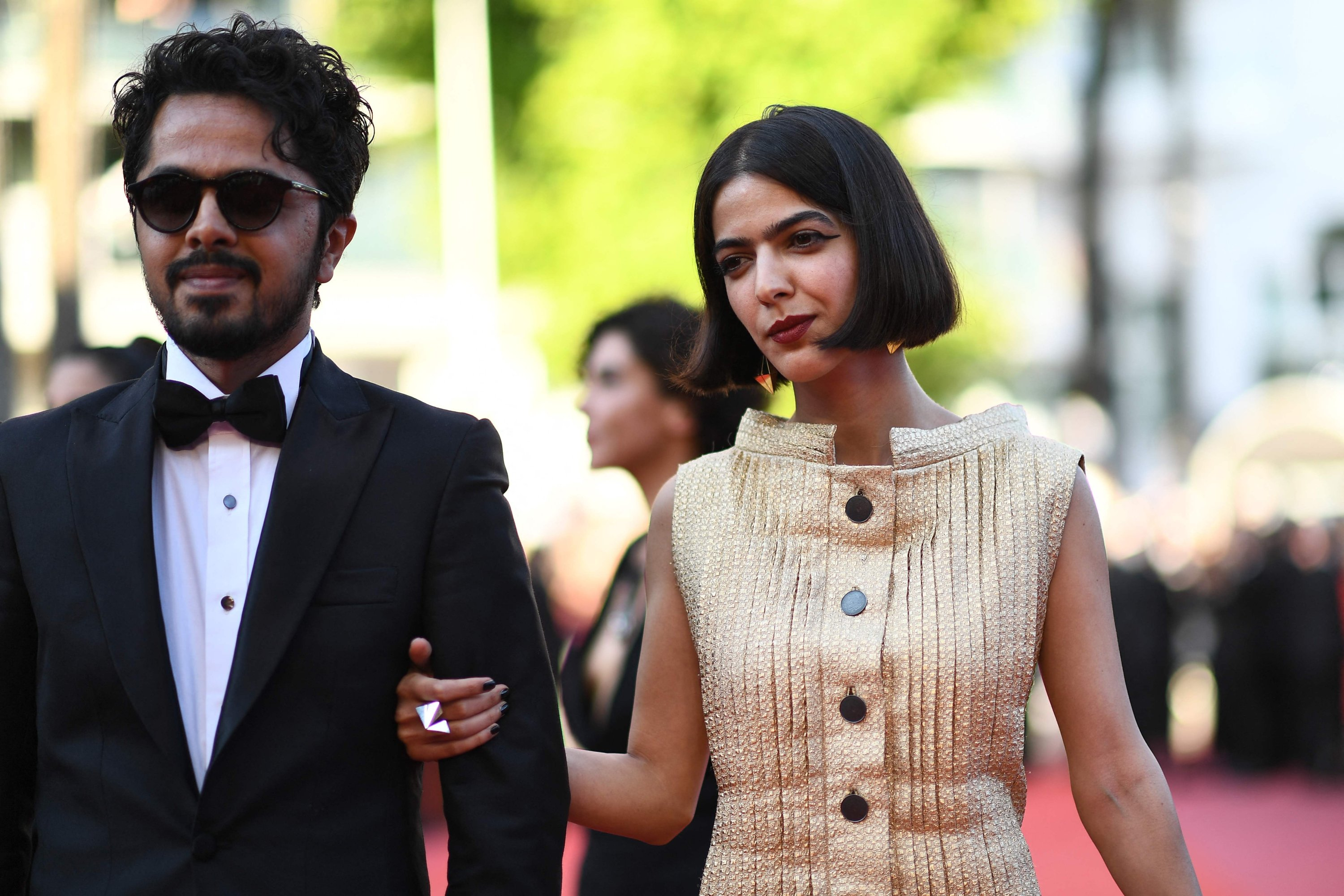 """Iranian actor Panah Panahi (L) and actress Solmaz Panahi, both children of film director Jafar Panahi, arrive for the screening of the film """"The Man Who Killed Don Quixote"""" at the 71st Cannes Film Festival in Cannes, France, May 19, 2018. (AFP Photo)"""