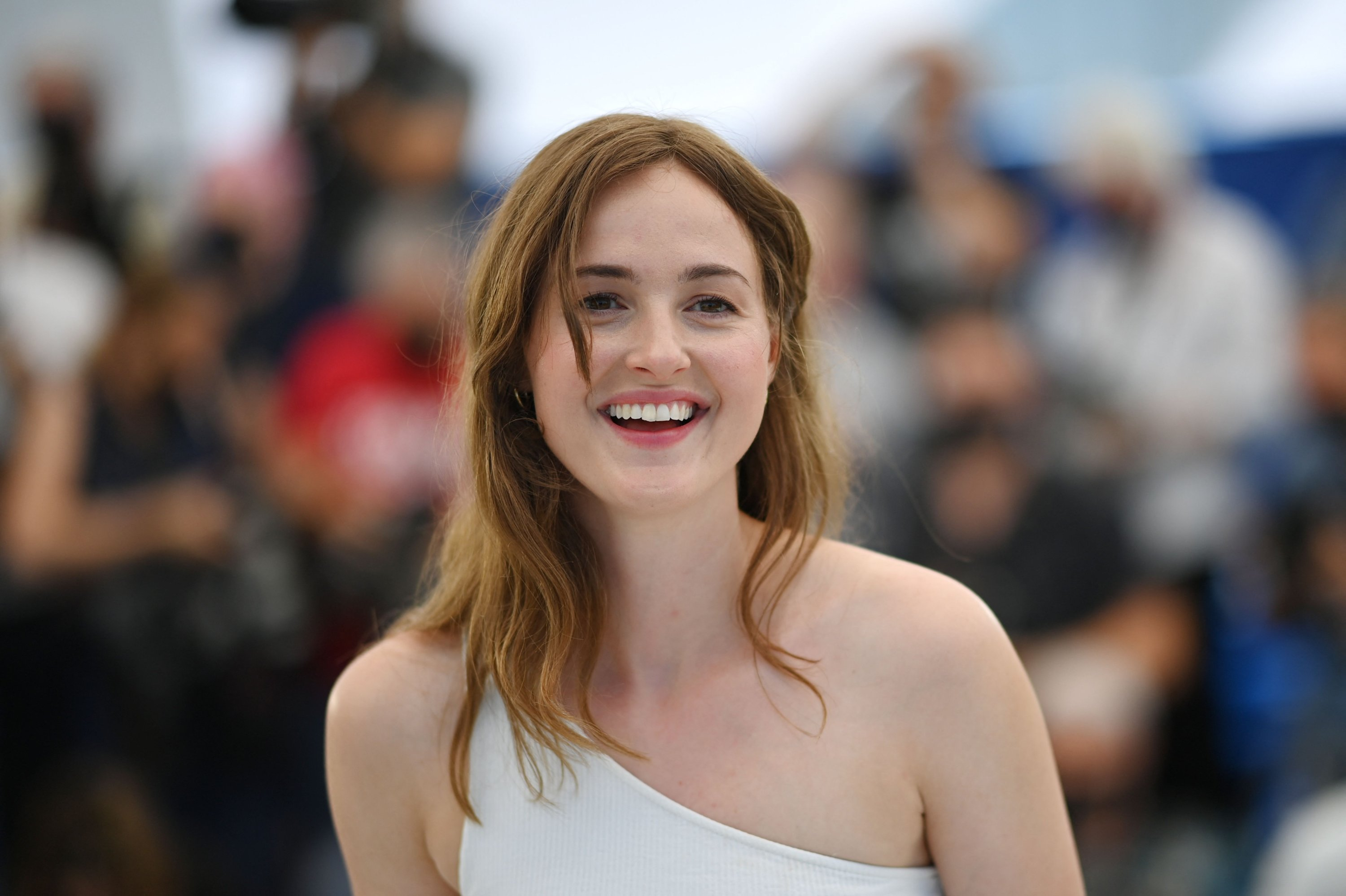 """Norwegian actress Renate Reinsve smiles during a photocall for the film """"Verdens Verste Menneske"""" (The Worst Person In The World) at the 74th Cannes Film Festival in Cannes, France, July 9, 2021. (AFP Photo)"""