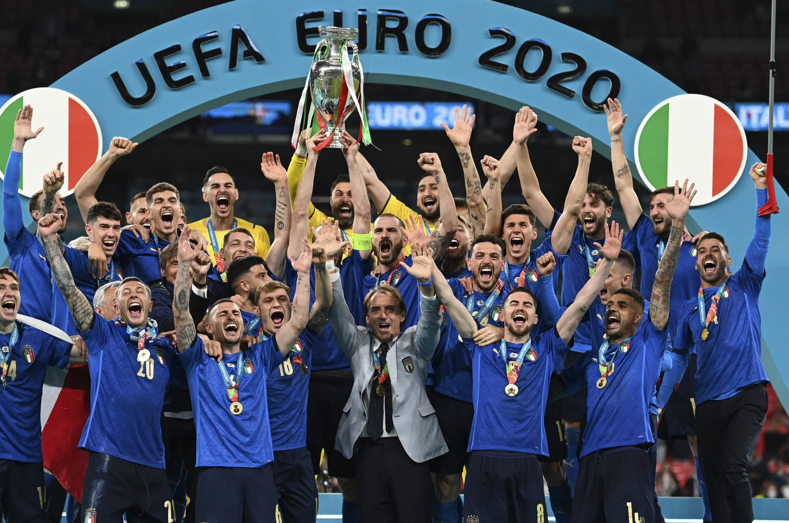 Italy team celebrates with the trophy after winning the Euro 2020 final against England at Wembley stadium in London, England, July 11, 2021. (AP Photo)