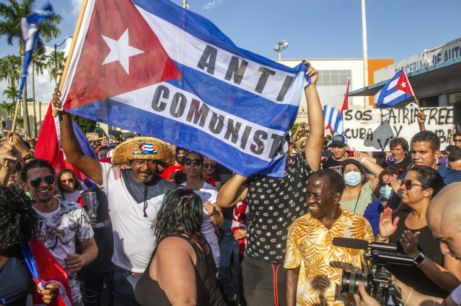 Cuban exiles rally at Versailles restaurant in Miami's Little Havana in support of protesters in Cuba as thousands of Cubans took to the streets in rare protests, Miami, Florida, U.S., Sunday, July 11, 2021. (AP Photo)