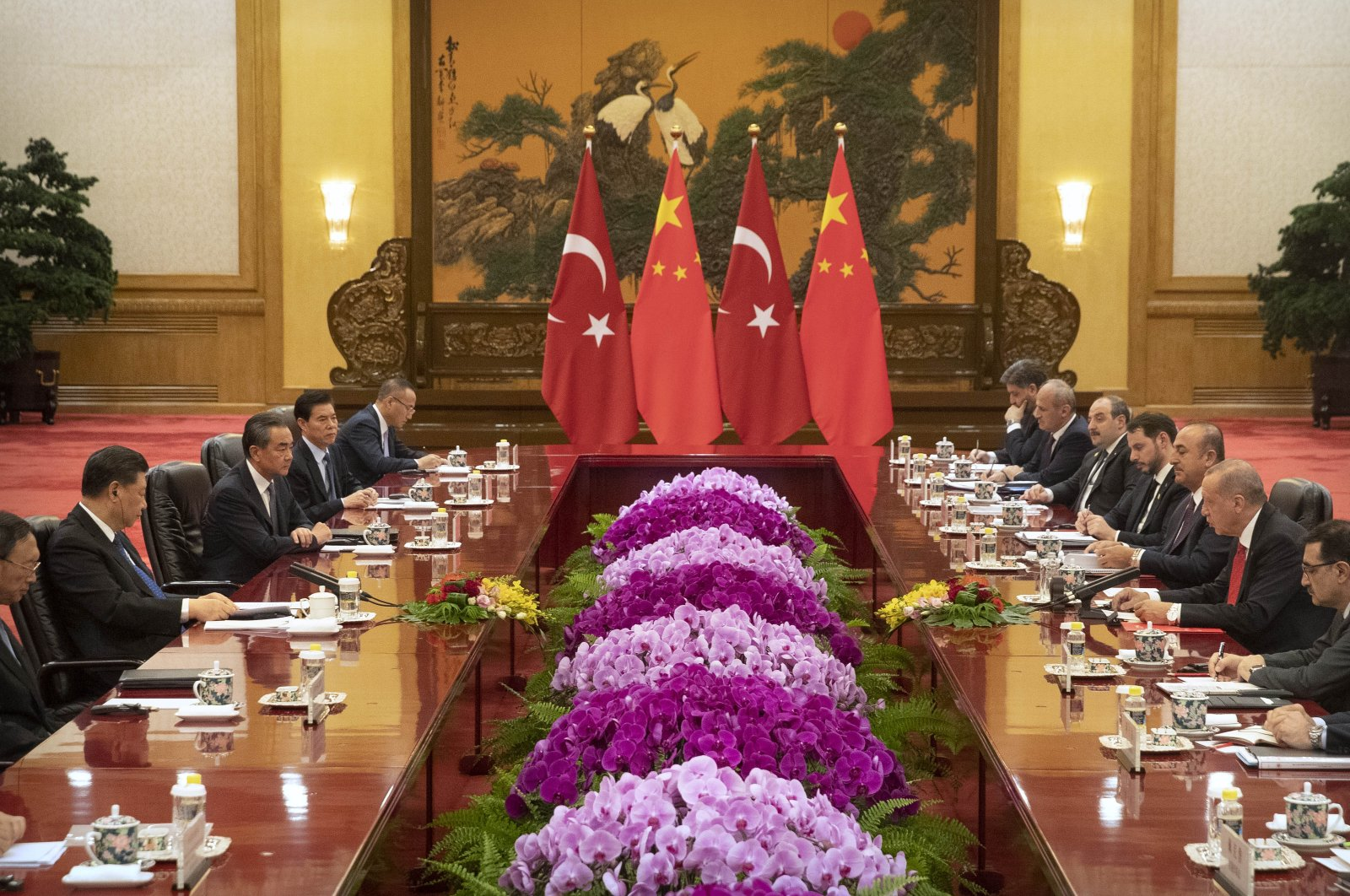 President Recep Tayyip Erdoğan (C-R) speaks during a meeting with Chinese President Xi Jinping (C-L) at the Great Hall of the People in Beijing, China, July 2, 2019. (Getty Images)