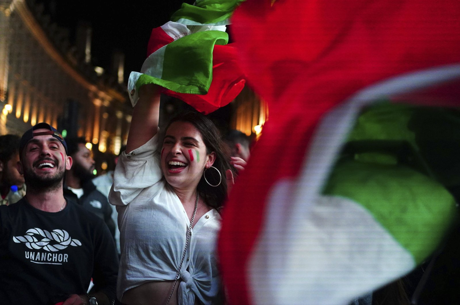 Italy fans celebrate in Piccadilly Circus in central London after their team won the UEFA Euro 2020 Final against England, July 11, 2021. (AP Photo)