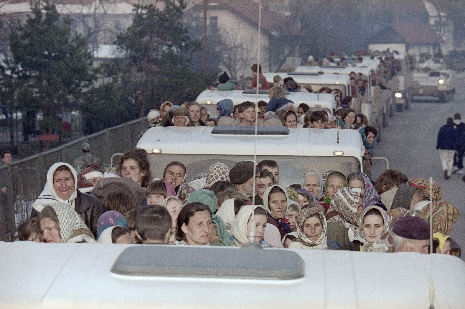 More than 2,300 refugees from the besieged Muslim enclave of Srebrenica arrive on a United Nations convoy in Tuzla, Bosnia and Herzegovina, March 29, 1993. (AP Photo)