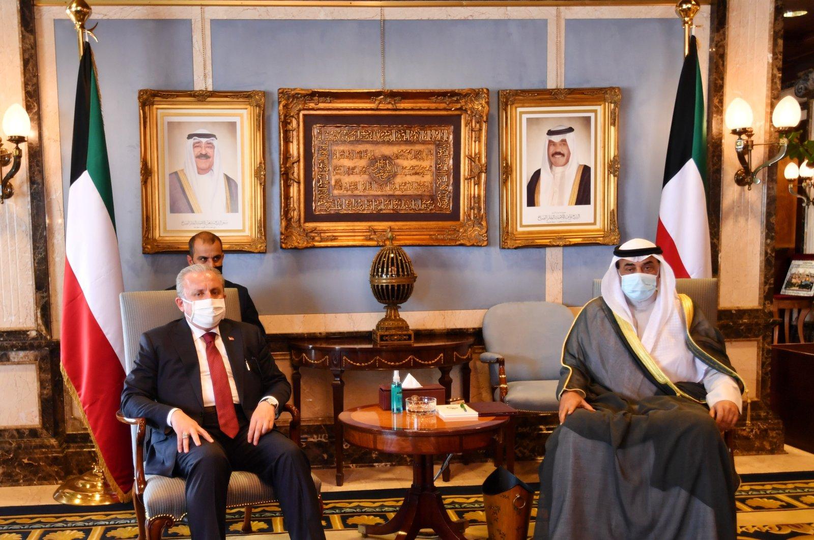 Turkish Parliament Speaker Mustafa Şentop (L) meets with Kuwaiti Prime Minister Sabah Al-Khalid Al-Sabah at Bayan Palace, Kuwait, July 12, 2021. (AA Photo)