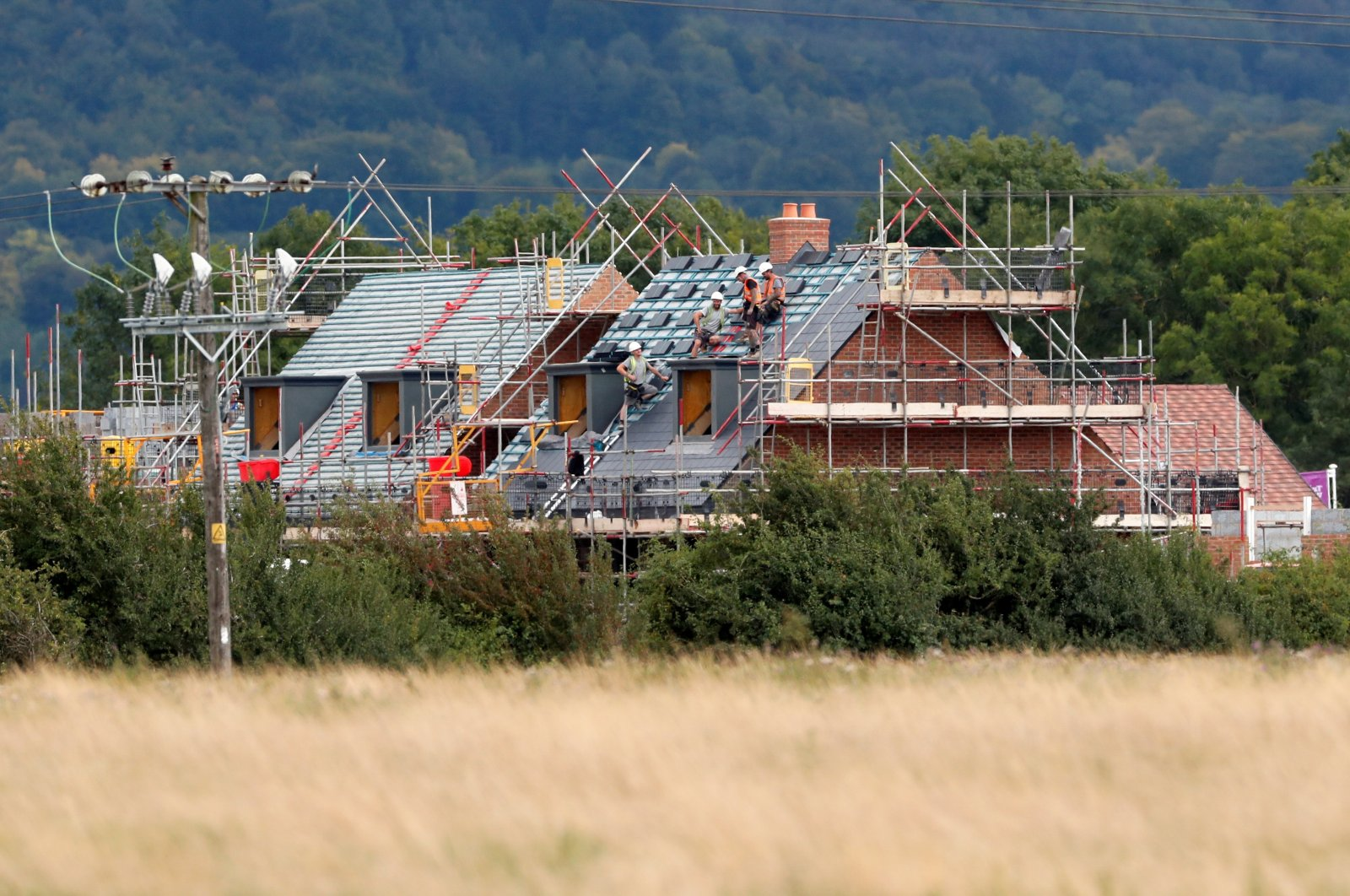 Construction workers build a new house in Aylesbury, Britain, Aug. 6, 2020. (Reuters Photo)